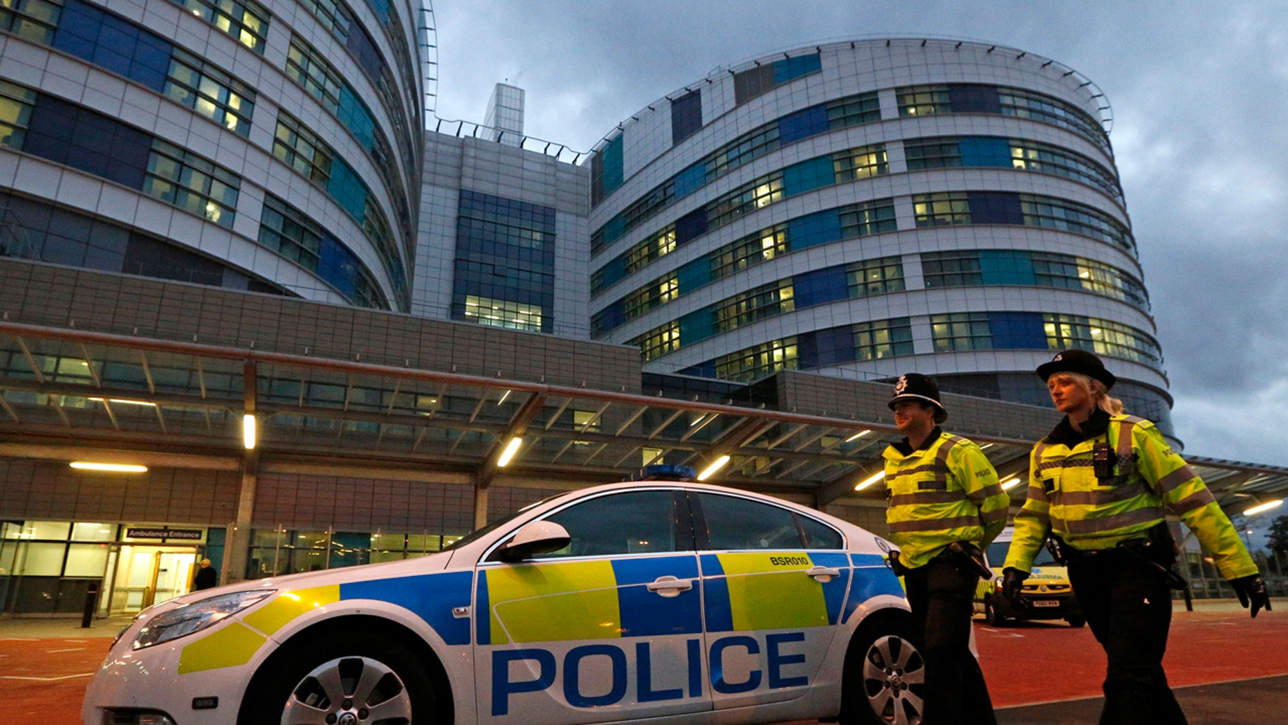 A surgeon who worked at Queen Elizabeth Hospital, seen above in 2012, admitted to etching his initials into two patients' livers during operations.