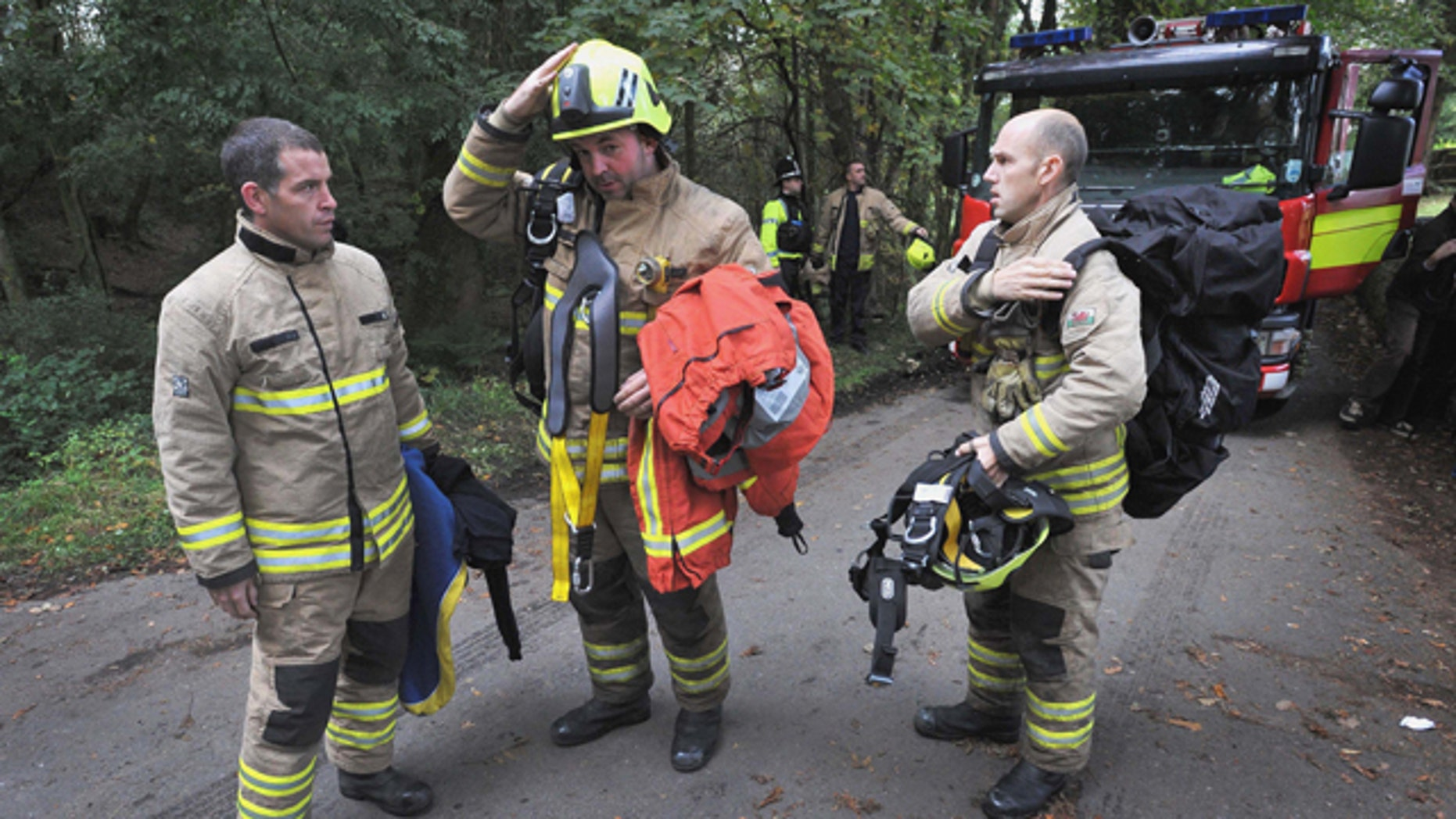 Sept. 16: Rescue workers arrive at the Gleision Colliery near Swansea, south Wales as a body is located in the flooded mine. British rescue workers found one miner dead after searching a flooded coal mine in south Wales, but pressed on Friday with the search for three others trapped underground.