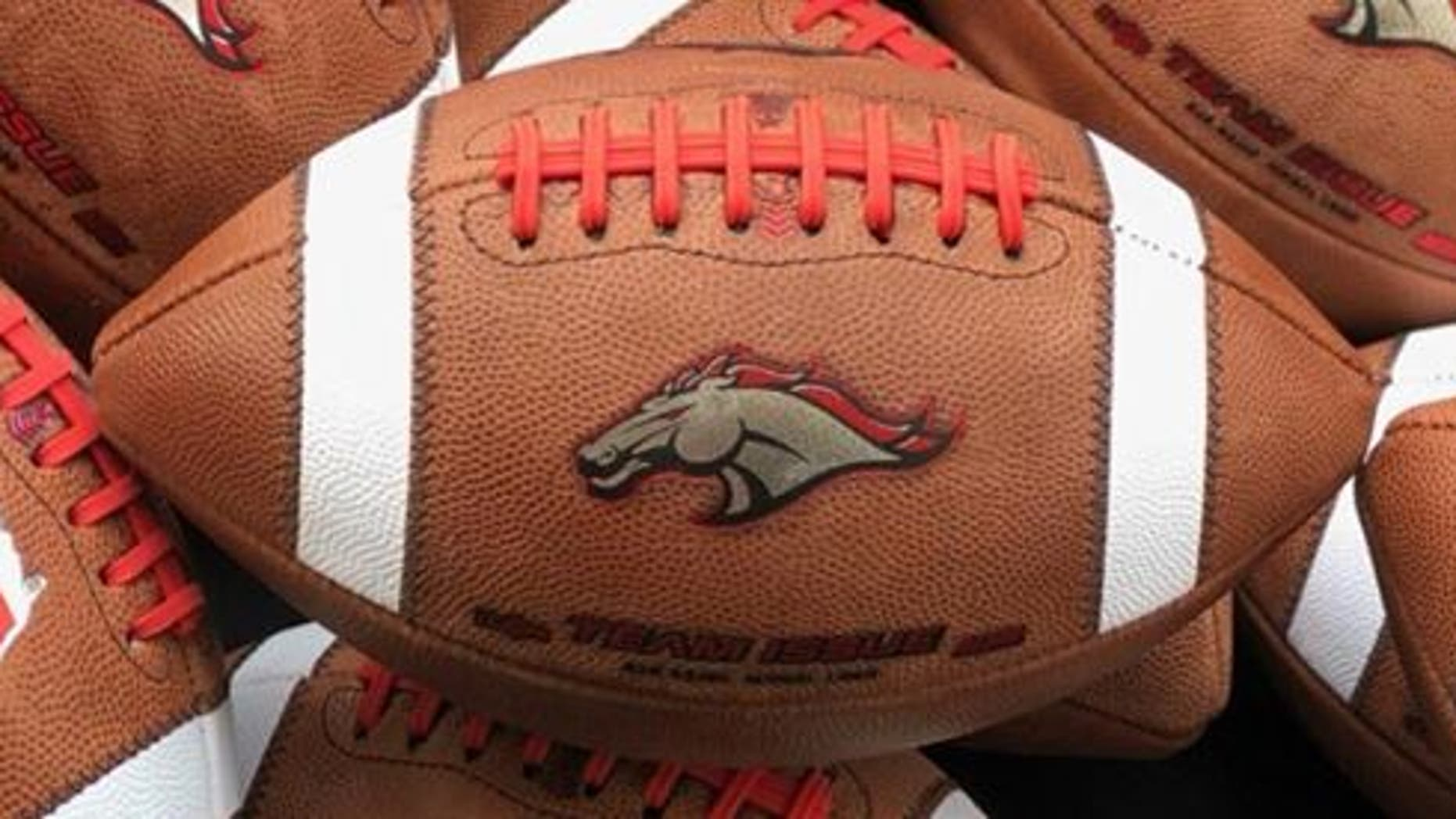 The logo of Brophy Prep's Broncos is seen on game footballs.