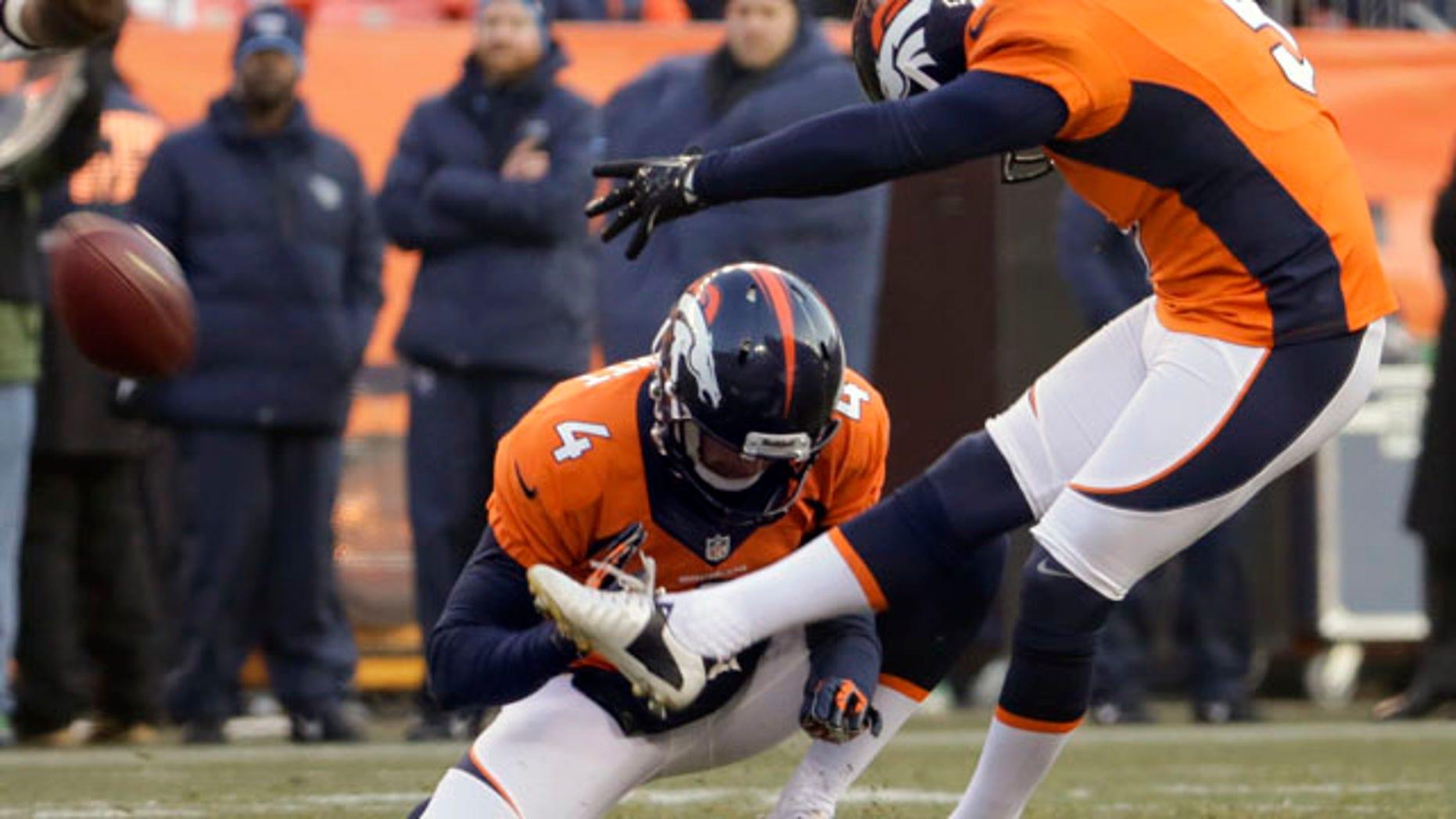 Dec. 8, 2013: Denver Broncos kicker Matt Prater, right, kicks a 64-yard field goal as Britton Colquitt holds during the first half of an NFL football game against the Tennessee Titans.