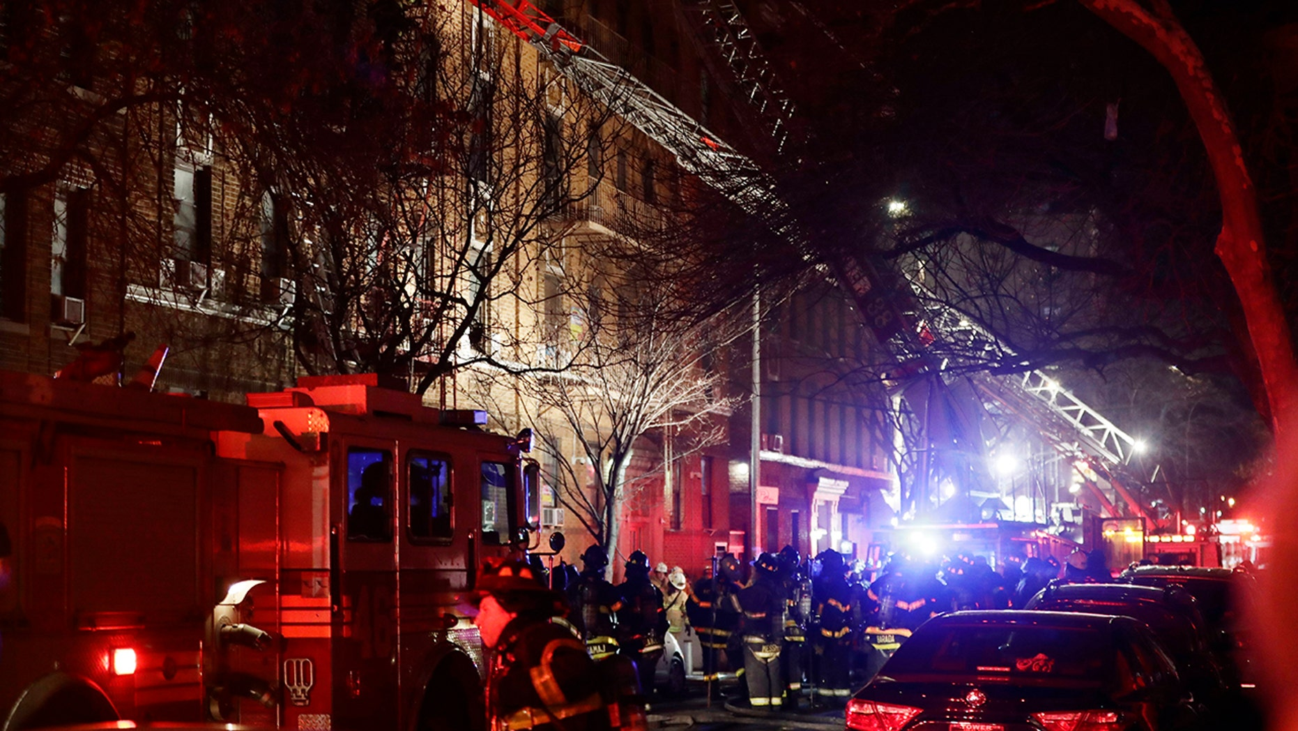 In this Dec. 28, 2017, file photo, firefighters respond to a deadly building fire in the Bronx borough of New York.
