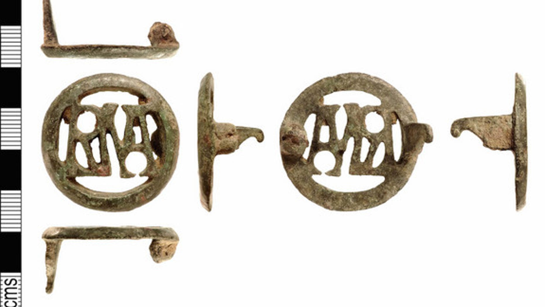"This copper brooch contains the letters ""RMA,"" which when read from left to right forms the monogram for ""Roma"" the city of Rome and its god. Read from right to left it forms the monogram for ""Amor"" the Latin name for Cupid, the god of Love. Th"