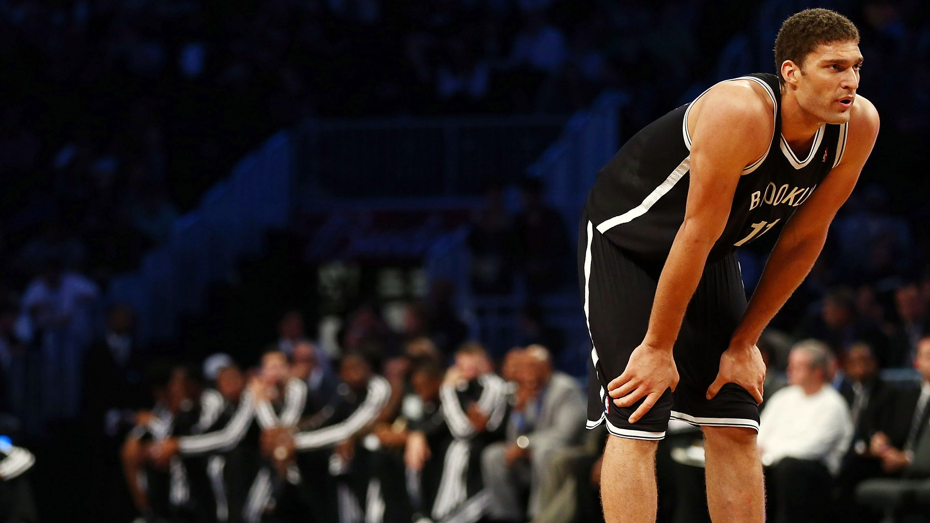 Brook Lopez looks on before taking a free throw during a preseason game against the Washington Wizards at the Barclays Center on October 15, 2012 in New York City.