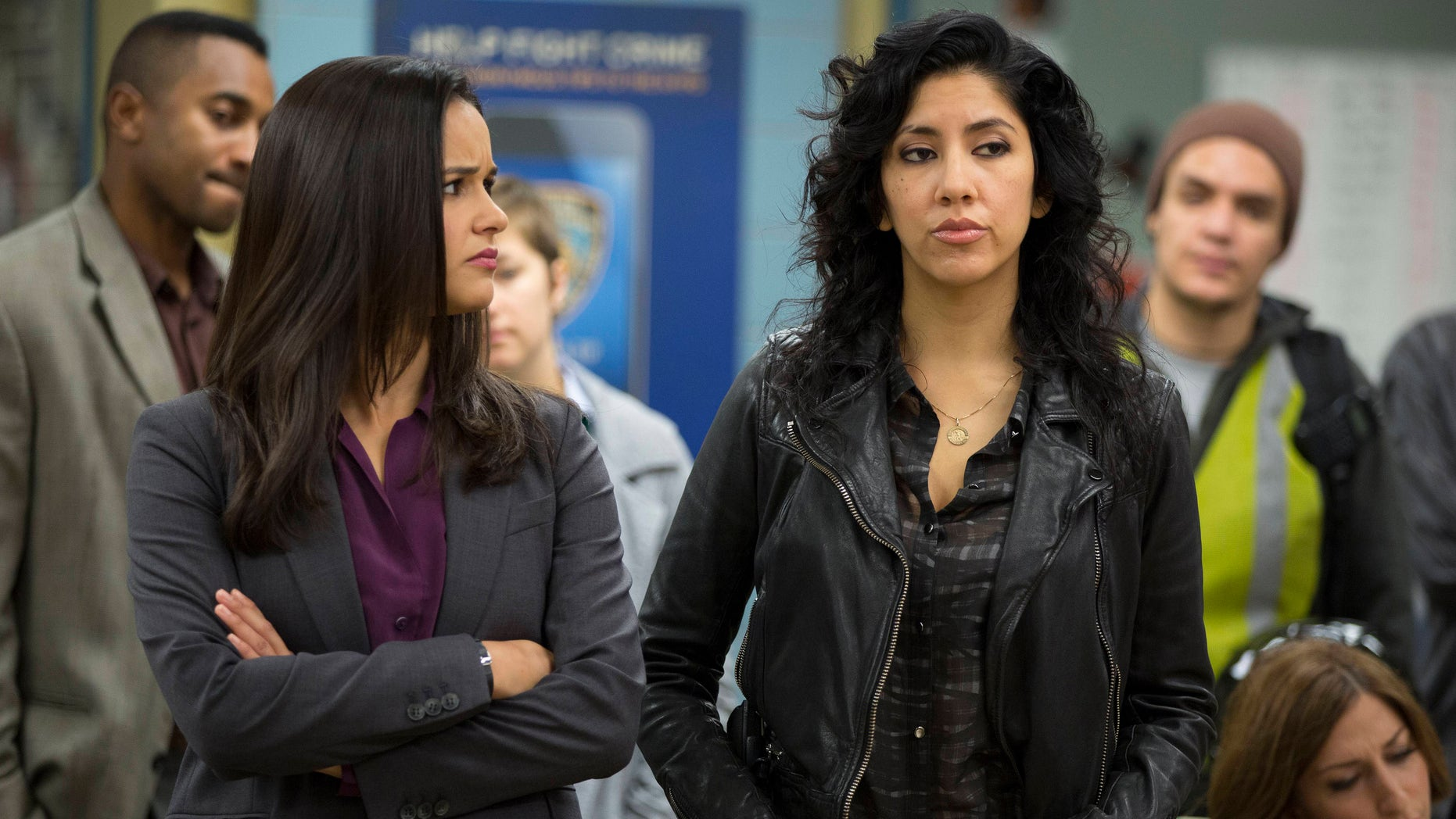 """In this image released by Fox, Melissa Fumero, left, and Stephanie Beatriz appear in a scene from the comedy series, """"Brooklyn Nine-Nine."""" Beatriz worked extensively in theater and enjoyed the freedom of appearing in a range of âcolorblindâ stage roles as well as playing specifically Latina characters. (AP Photo/Fox, John Fleenor)"""