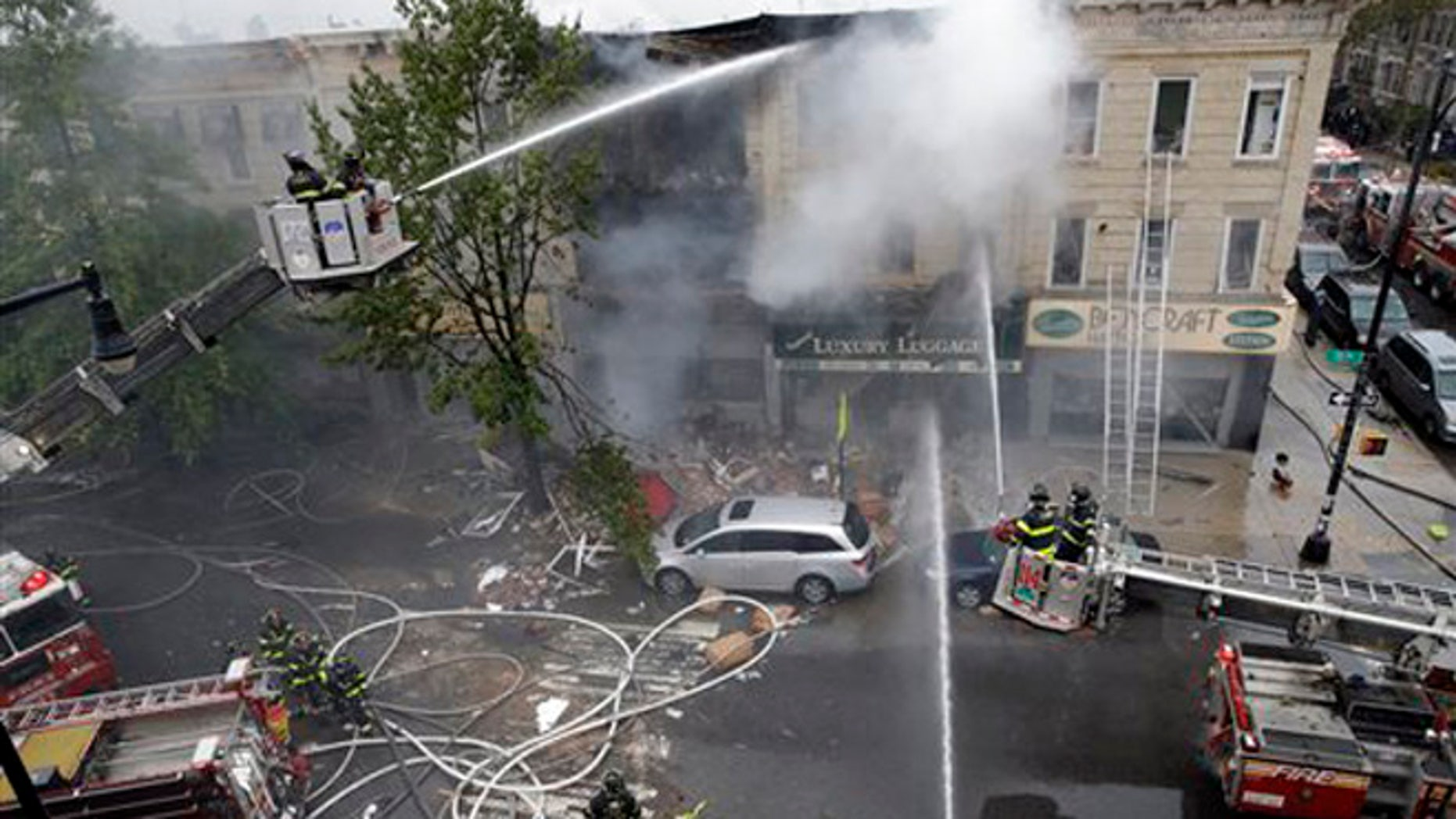 Oct. 3, 2015: Firefighters work at the at the scene of an explosion at a three-story building in the Borough Park neighborhood in the Brooklyn borough of New York.