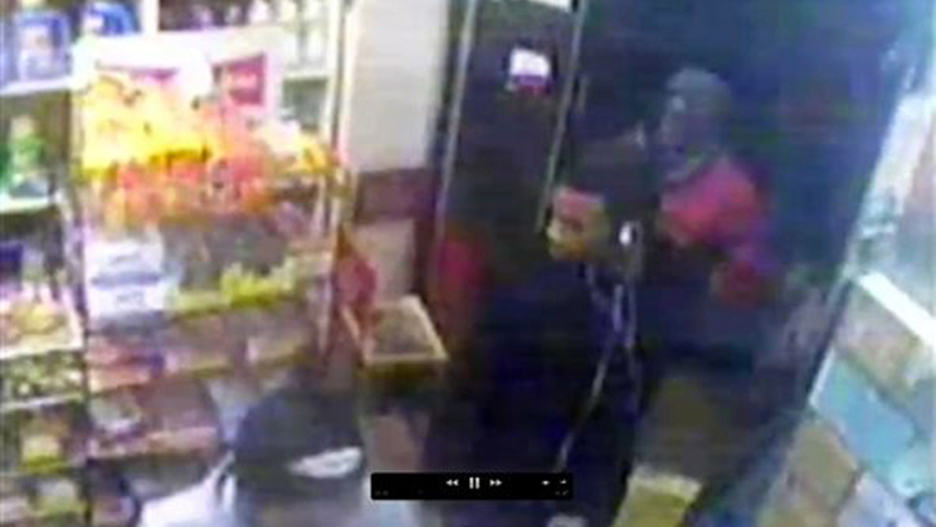 This image from security video provided by the New York Police Department, from a security camera at a bodega at 635 Watkins St. in the Brooklyn borough of New York, shows three men who are wanted by police in connection with the gang rape of an 18-year-old woman who was walking in the nearby Osborn Playground with her father later the same evening.