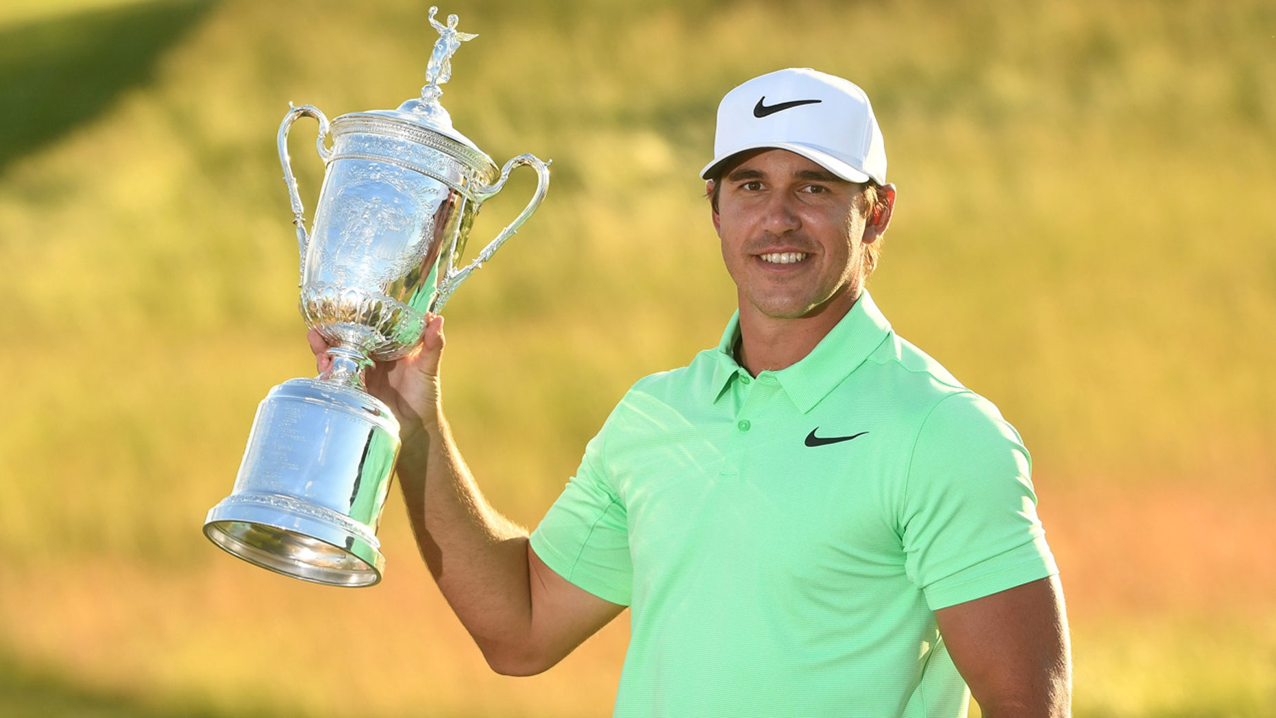 Brooks Koepka poses with the trophy after winning the U.S. Open golf tournament at Erin Hills.