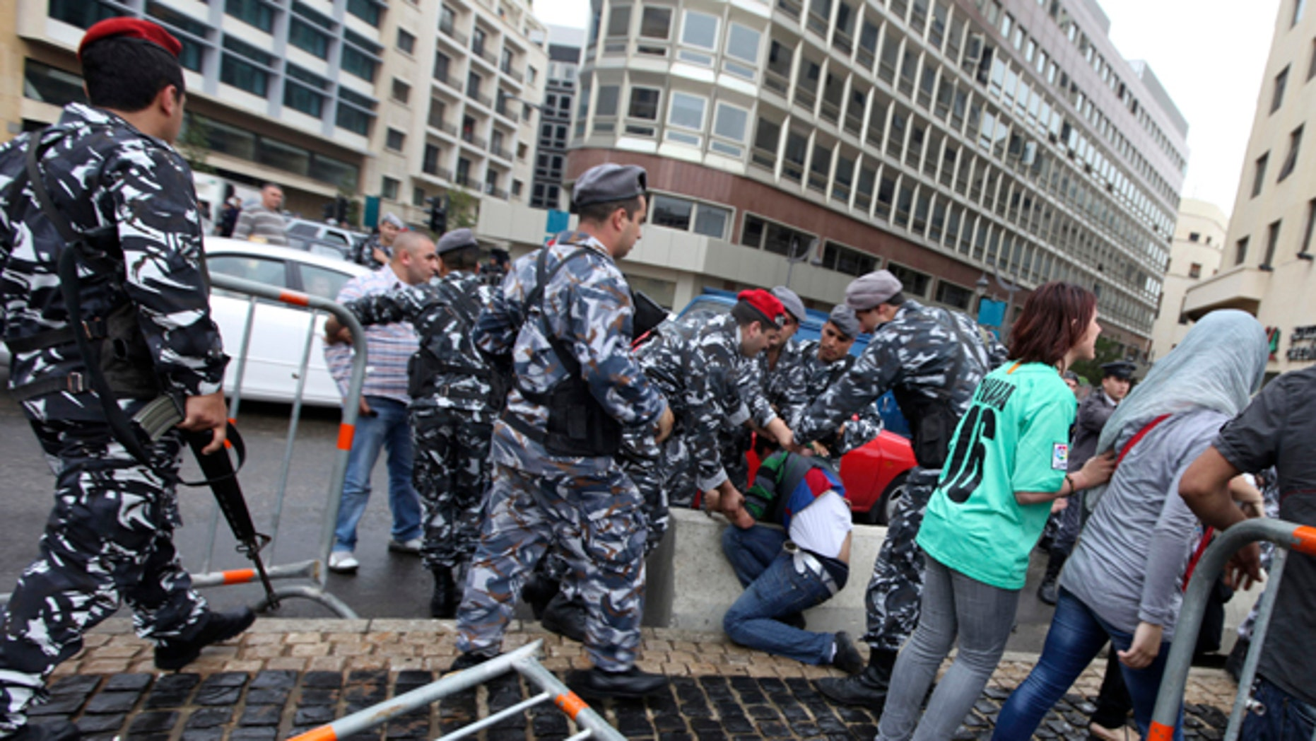 April 28: Lebanese police arrest a man as protesters tried to block a road during a sit-in against the sectarian makeup of Lebanon's government in Beirut, Lebanon. (AP)