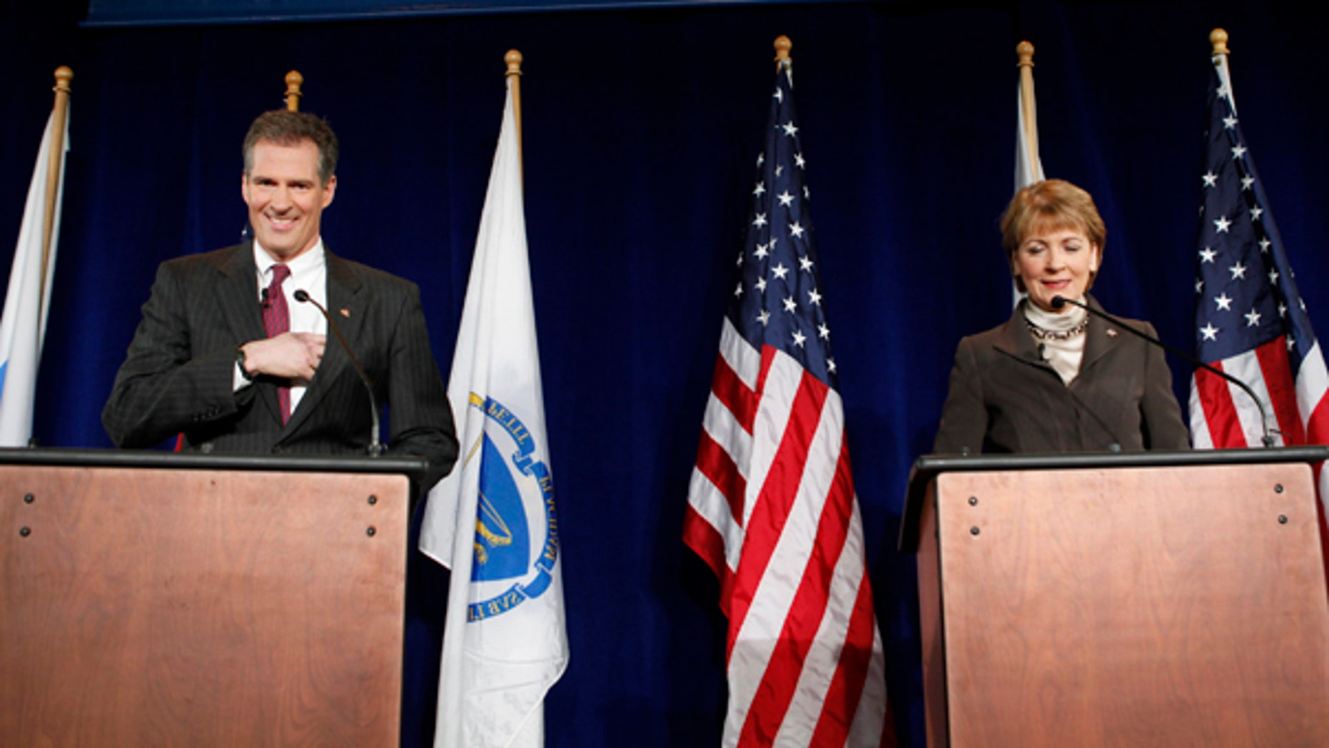 Monday: Republican Scott Brown and Democrat Martha Coakley make last minute preparations before a debate on the campus of the University of Massachusetts in Boston. (AP Photo)
