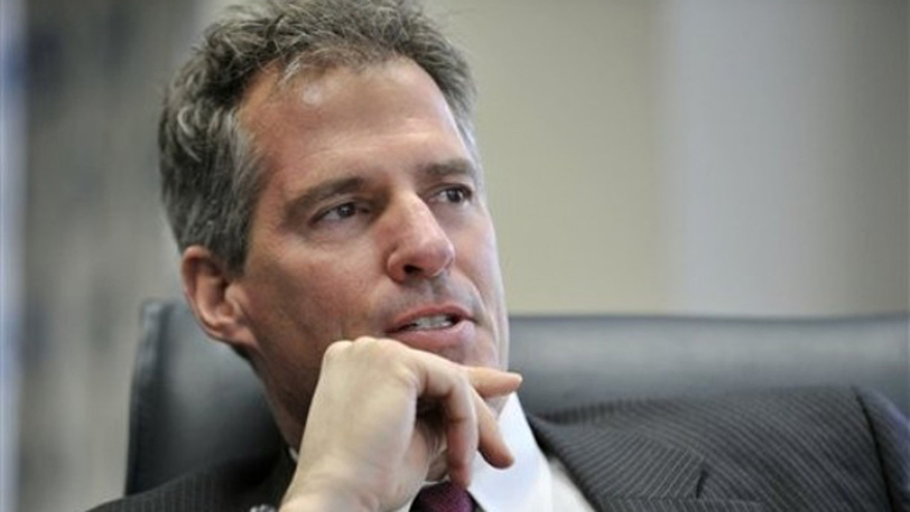 In this Jan. 11 photo, Sen. Scott Brown answers a question during an interview at his office in Boston.