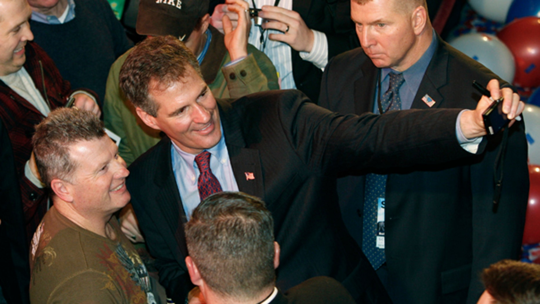 Tuesday: U.S. Senator-Elect Scott Brown takes a photo of himself and a supporter at his victory party after winning the special election to fill the seat left vacant by the death of Massachusetts Sen. Edward Kennedy. (AP Photo)