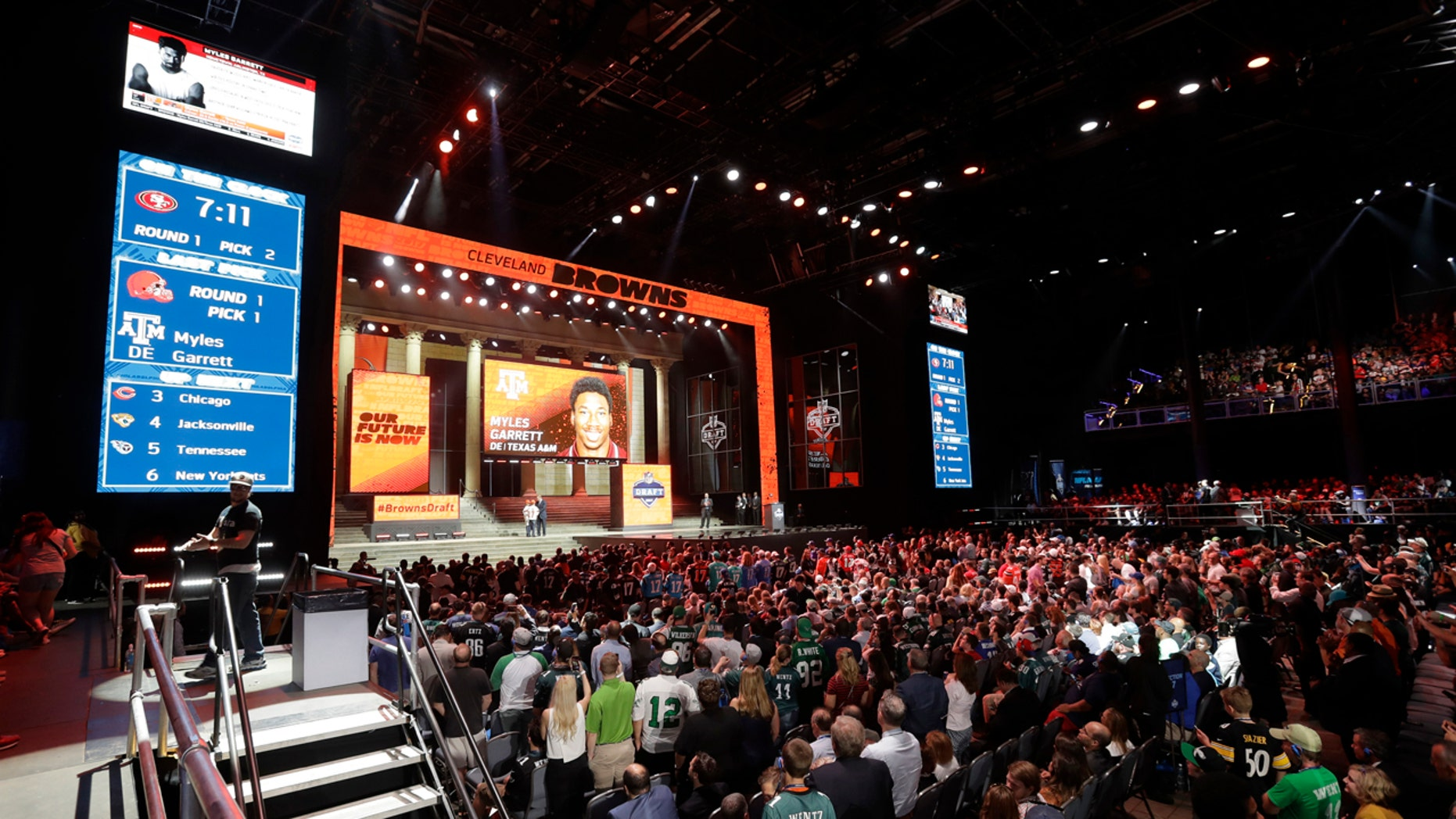 Fans cheer after Texas A&M's Myles Garrett was selected with the number one overall pick by the Cleveland Browns during the first round of the 2017 NFL football draft, Thursday, April 27, 2017, in Philadelphia.