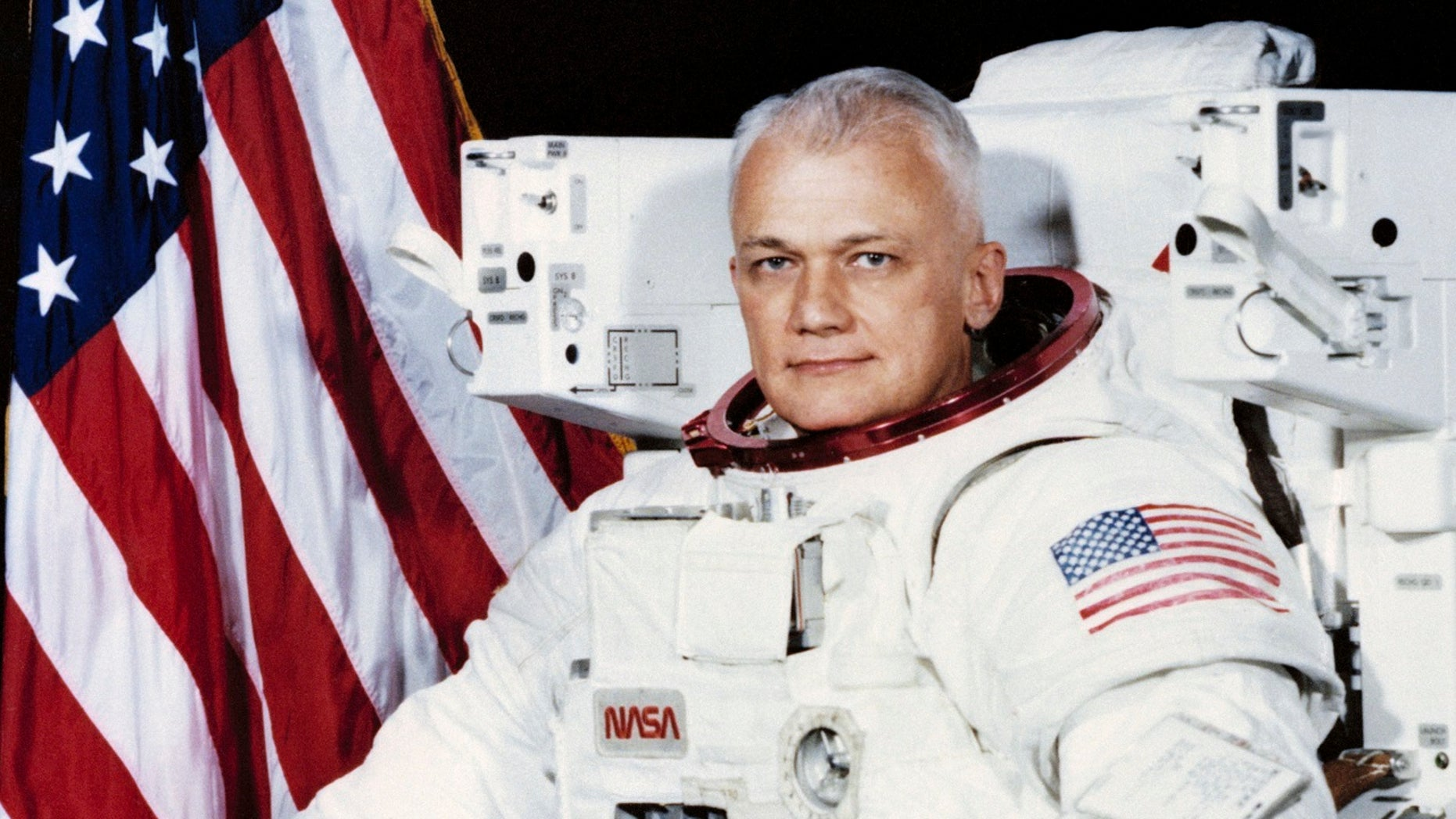 File 1982: Astronaut Bruce McCandless wears a shuttle Extravehicular Activity (EVA) Suit with Manned Maneuvering Unit (MMU) in Houston. The NASA Johnson Space Center says he died Thursday.