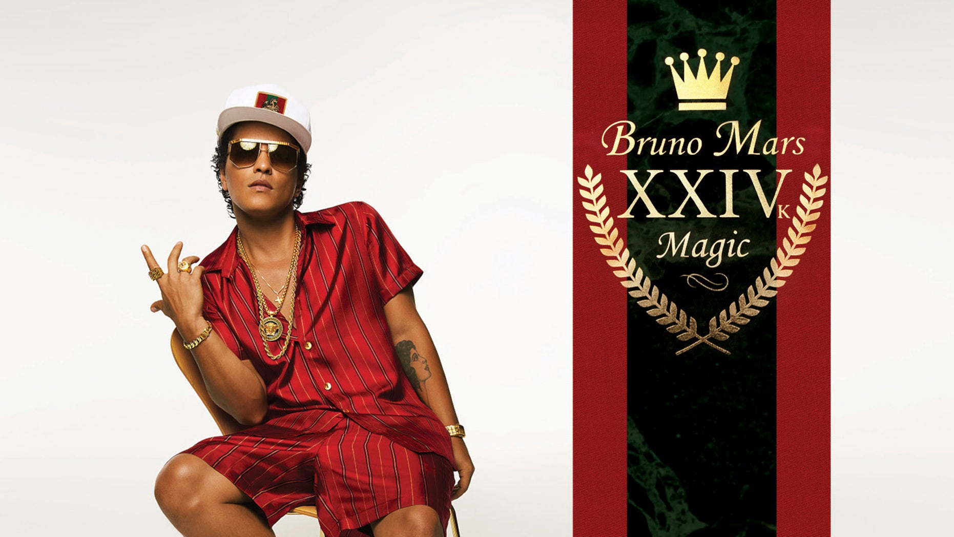 """This cover image released by Atlantic Records shows, """"24K Magic,"""" the latest release by Bruno Mars. Mars, 31, said the album was inspired by his love for R&B acts like New Edition, Boyz II Men and Jodeci. (Atlantic Records via AP)"""