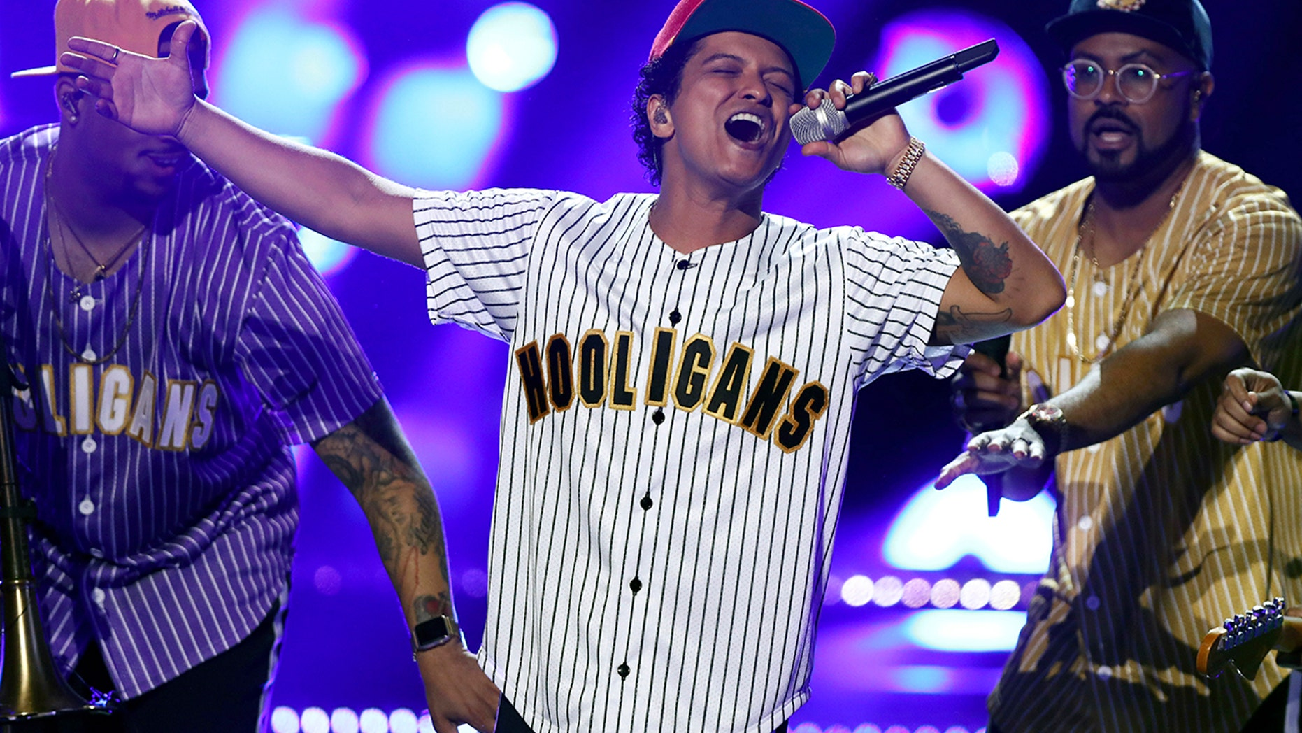 Bruno Mars, seen in this file photo on June 25, 2017, was forced to temporarily stop his concert in Glasgow, Scotland on Tuesday after a firework caused a small fire.