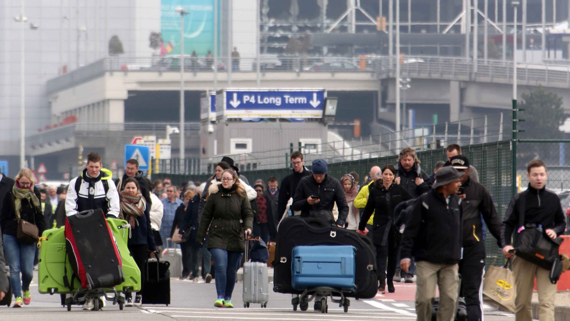 Passengers are evacuated from Zaventem Bruxelles International Airport on March 22, 2016 in Brussels.