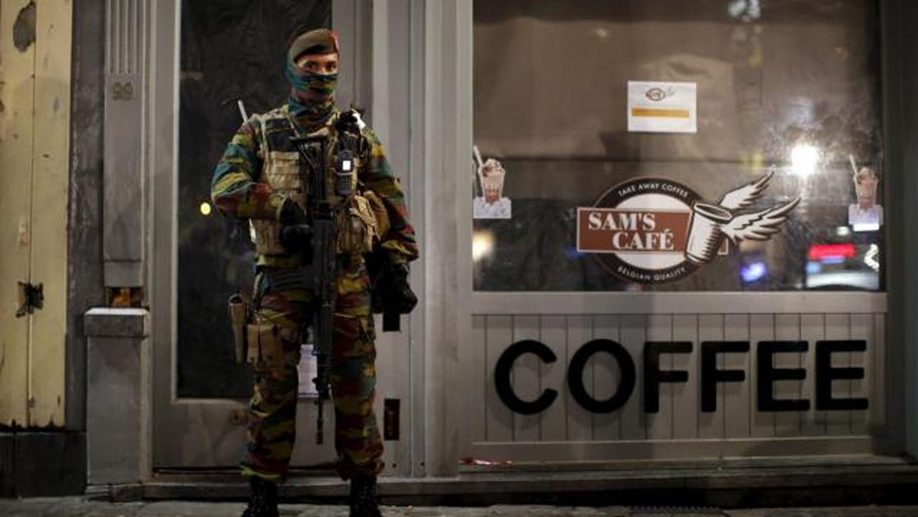 Belgian soldiers patrol in central Brussels as the city is on lockdown.