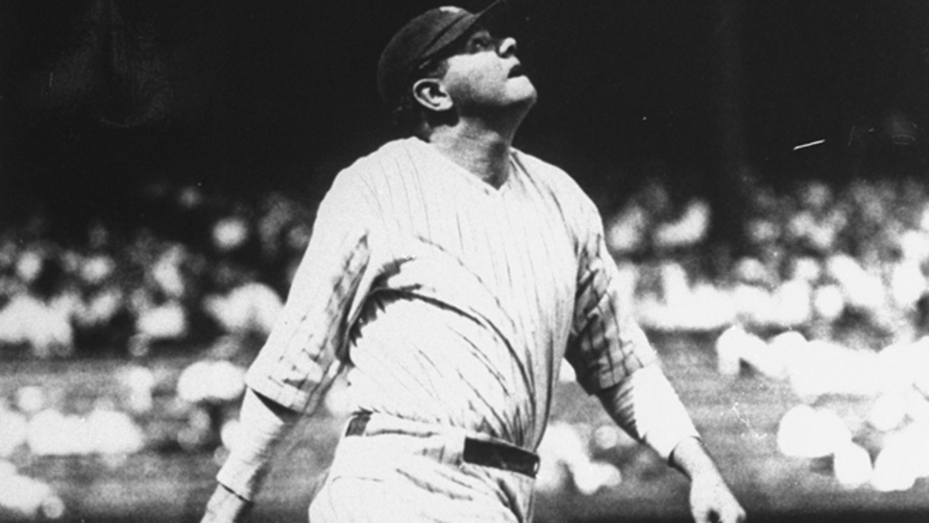 FILE 1927: Babe Ruth lofts another home run into the right field upper deck at Yankee Stadium in New York on the way to his 60-home run year.