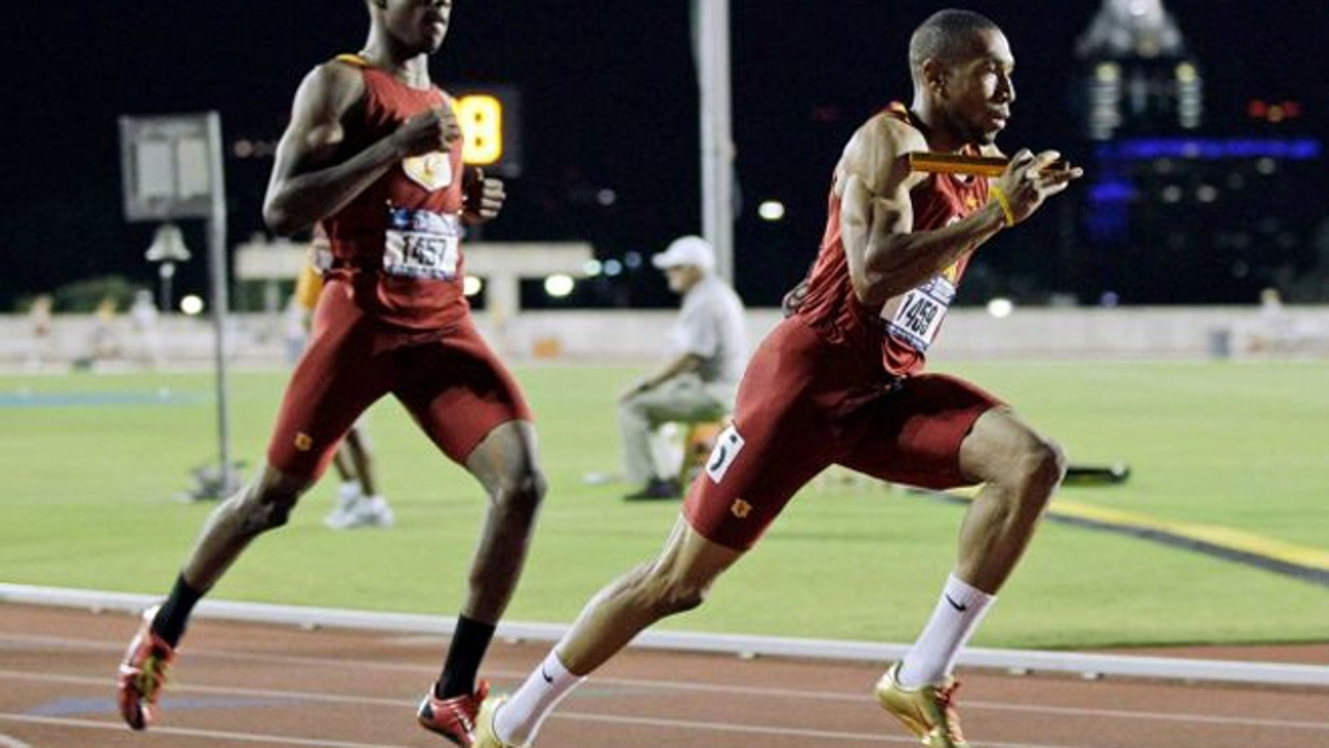 May 26, 2012: In this photo, Southern California sprinter Bryshon Nellum, right, runs past teammate Josh Mance, left, after the baton handoff during the men's 4X400 meter relay at the NCAA Track and Field Championships West Preliminary in Austin, Texas.