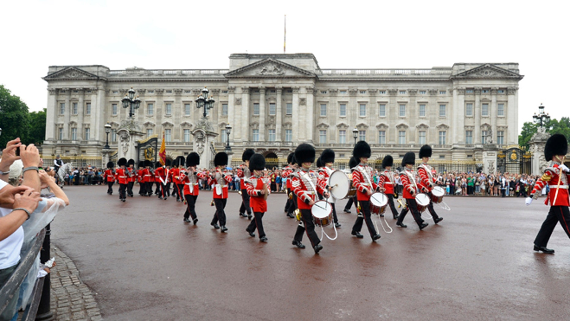 July 23: Guardsmen perform the Changing the Guard ceremony in front of Buckingham Palace, in central London.