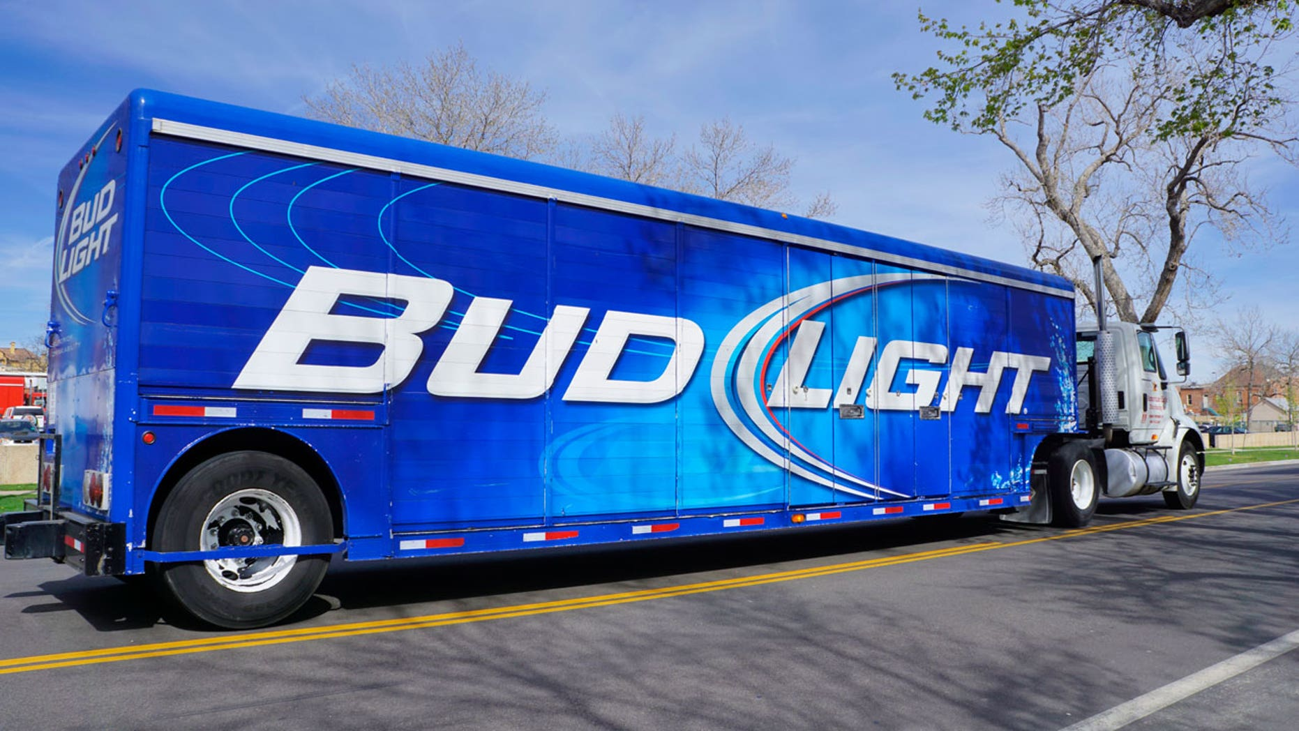 A Bud Light truck flipped over and spilled its contents on an Arizona roadway.