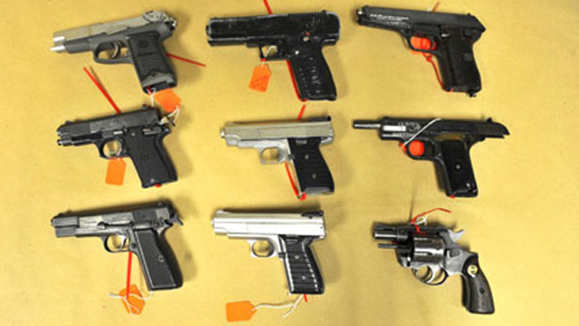 FILE 2012: Buffalo police confiscated nine illegal handguns in connection with a gun trafficking operation that stretched from the Decatur, Georgia area to Buffalo. The city has been focused on reducing the number of illegal guns on the street.