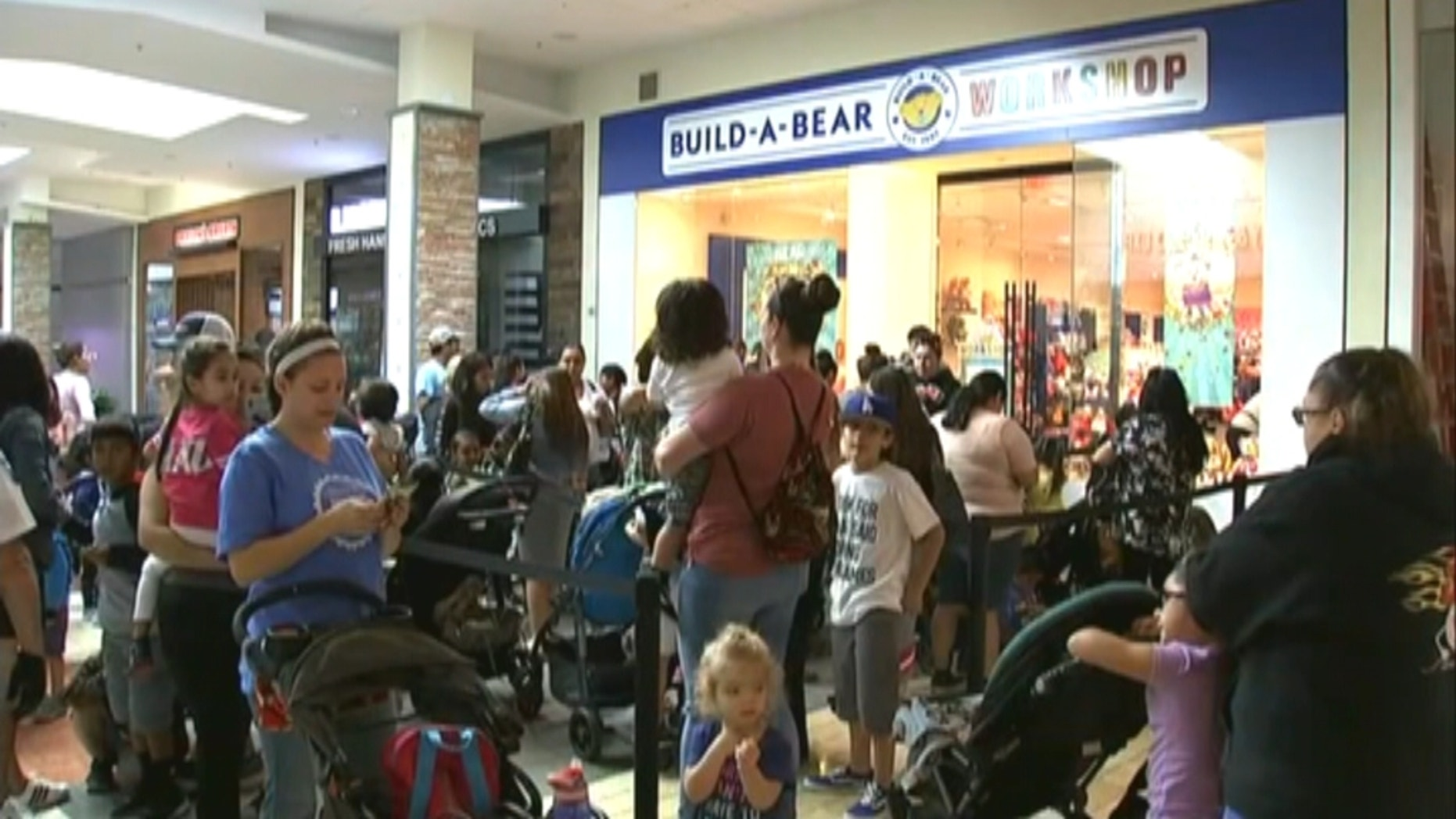 Parents on Thursday waited in line with their children for hours to get their hands on a discounted stuffed toy. (KGO via NNS)