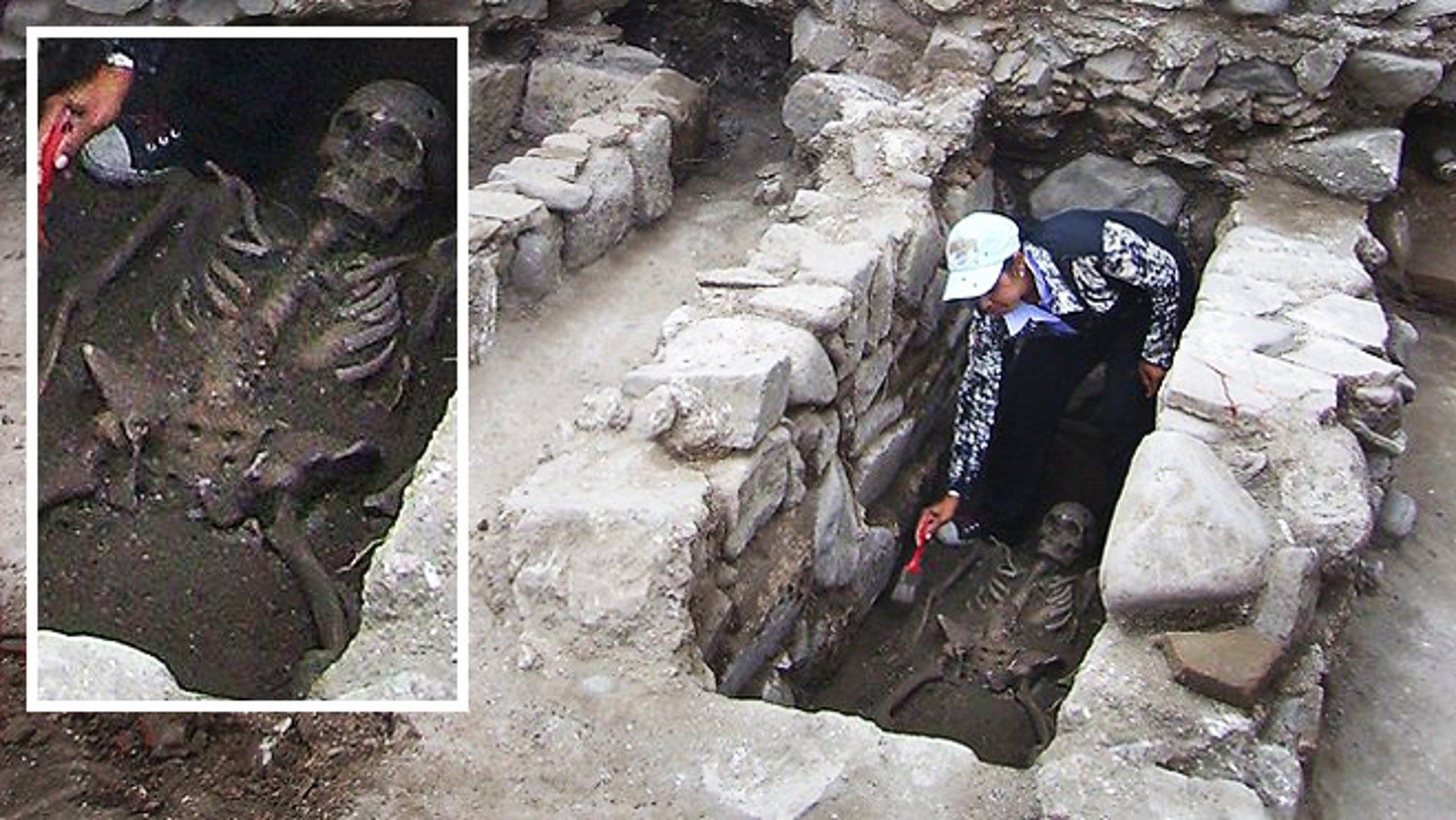 Restless dead: An archaeologist cleans a skeleton during excavations in Bulgaria, where the remains of two bodies were found pierced with iron rods to keep them from turning into vampires.