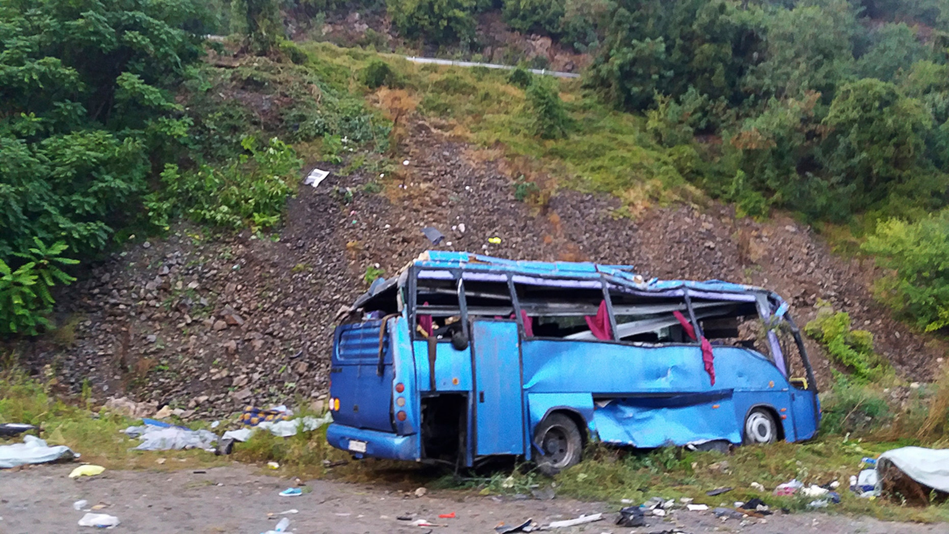 In this handout photo provided by the Bulgarian Interior Ministry, a view of a bus that crashed and overturned, near the town of Svoge, Saturday, Aug. 25, 2018.