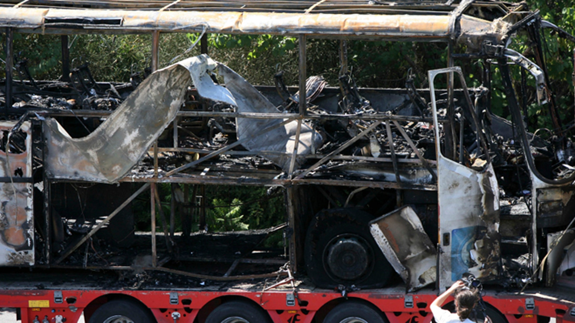 July 19, 2012: In this file photo, a damaged bus is transported out of Burgas airport, Bulgaria, a day after a deadly suicide attack on a bus full of Israeli vacationers.