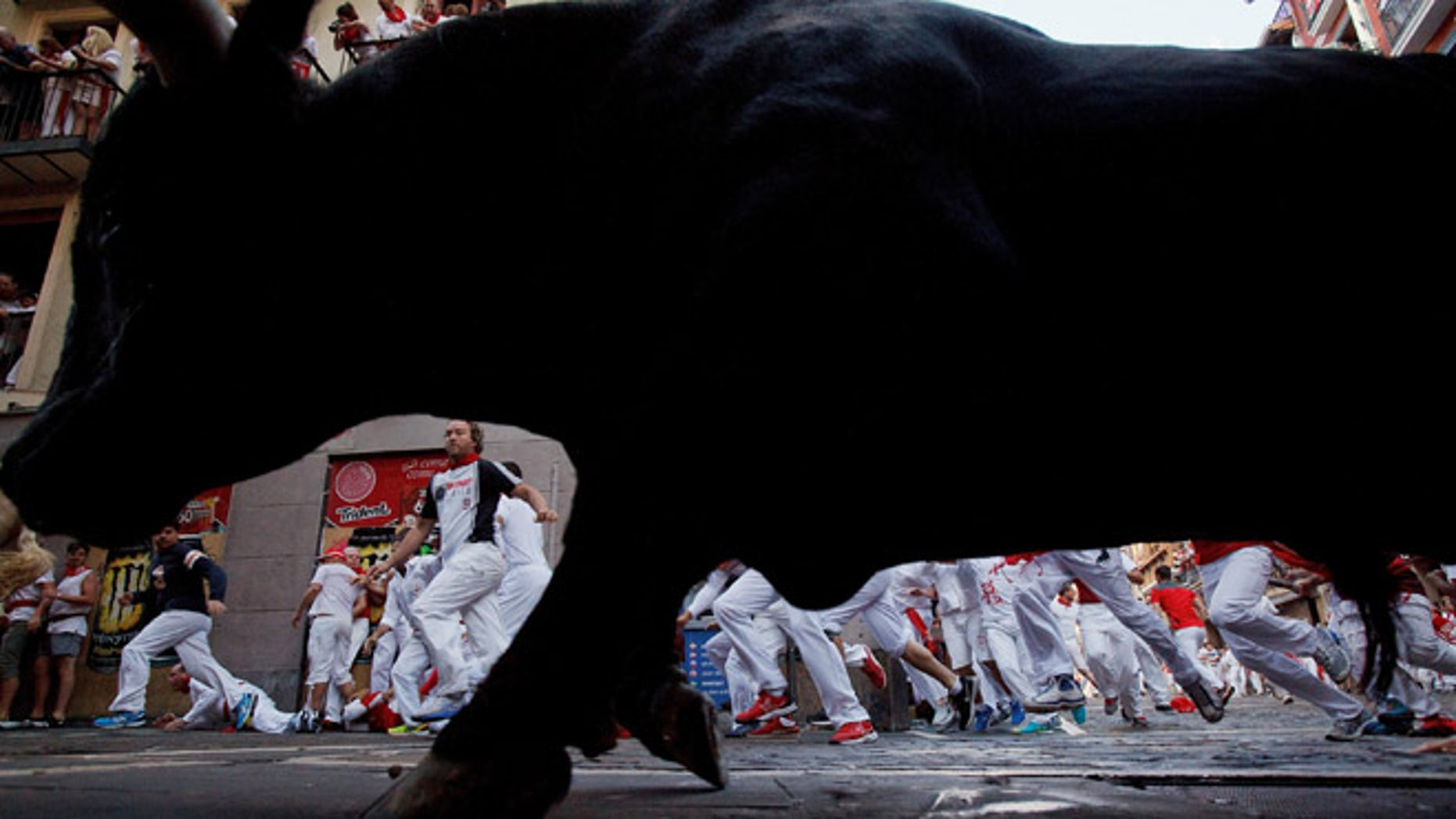 PAMPLONA, SPAIN - JULY 08:  Revellers run with Cebada Gago's fighting bulls entering Estafeta Street during the third day of the San Fermin Running of the Bulls festival on July 8, 2016 in Pamplona, Spain. The annual Fiesta de San Fermin, made famous by the 1926 novel of US writer Ernest Hemmingway entitled 'The Sun Also Rises', involves the daily running of the bulls through the historic heart of Pamplona to the bull ring.  (Photo by Pablo Blazquez Dominguez/Getty Images)