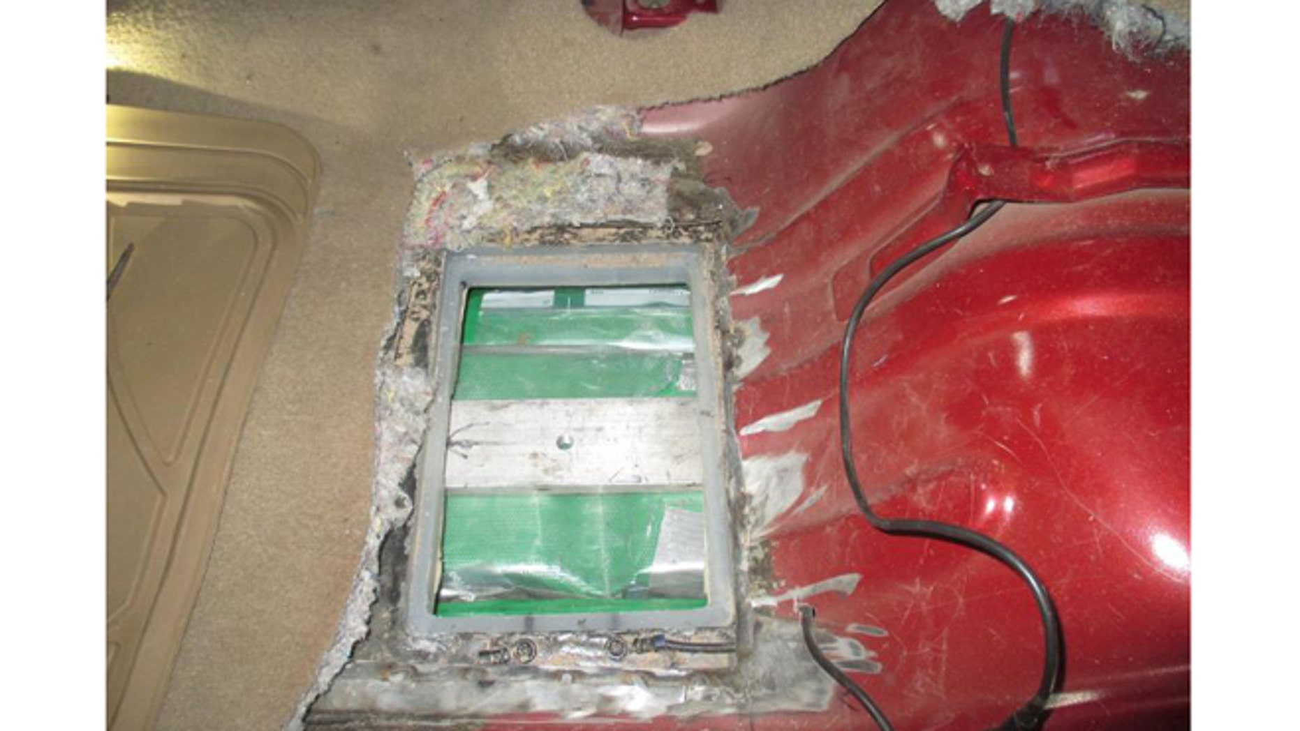 Officers removed the fuel tank and located green taped bundles of cocaine at a U.S.-Mexico border crossing.