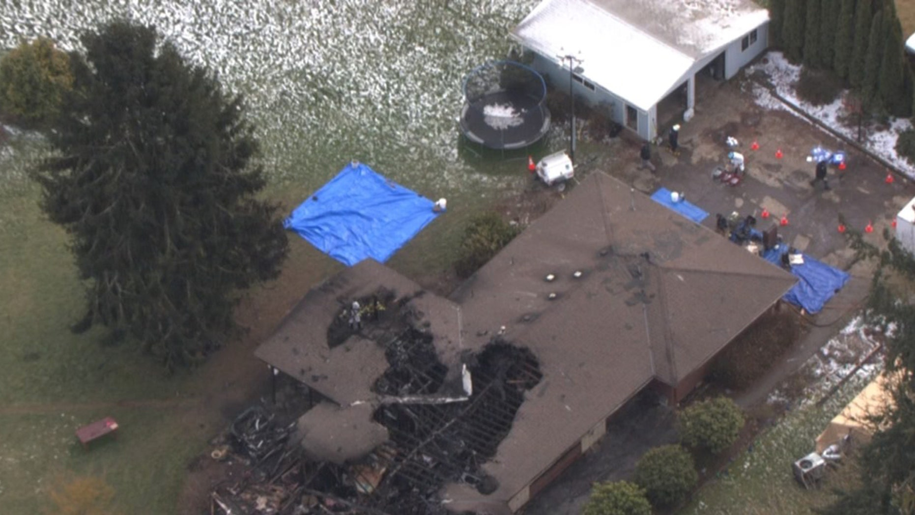 The burned home of the Kroeker family in Hubbard, Oregon.