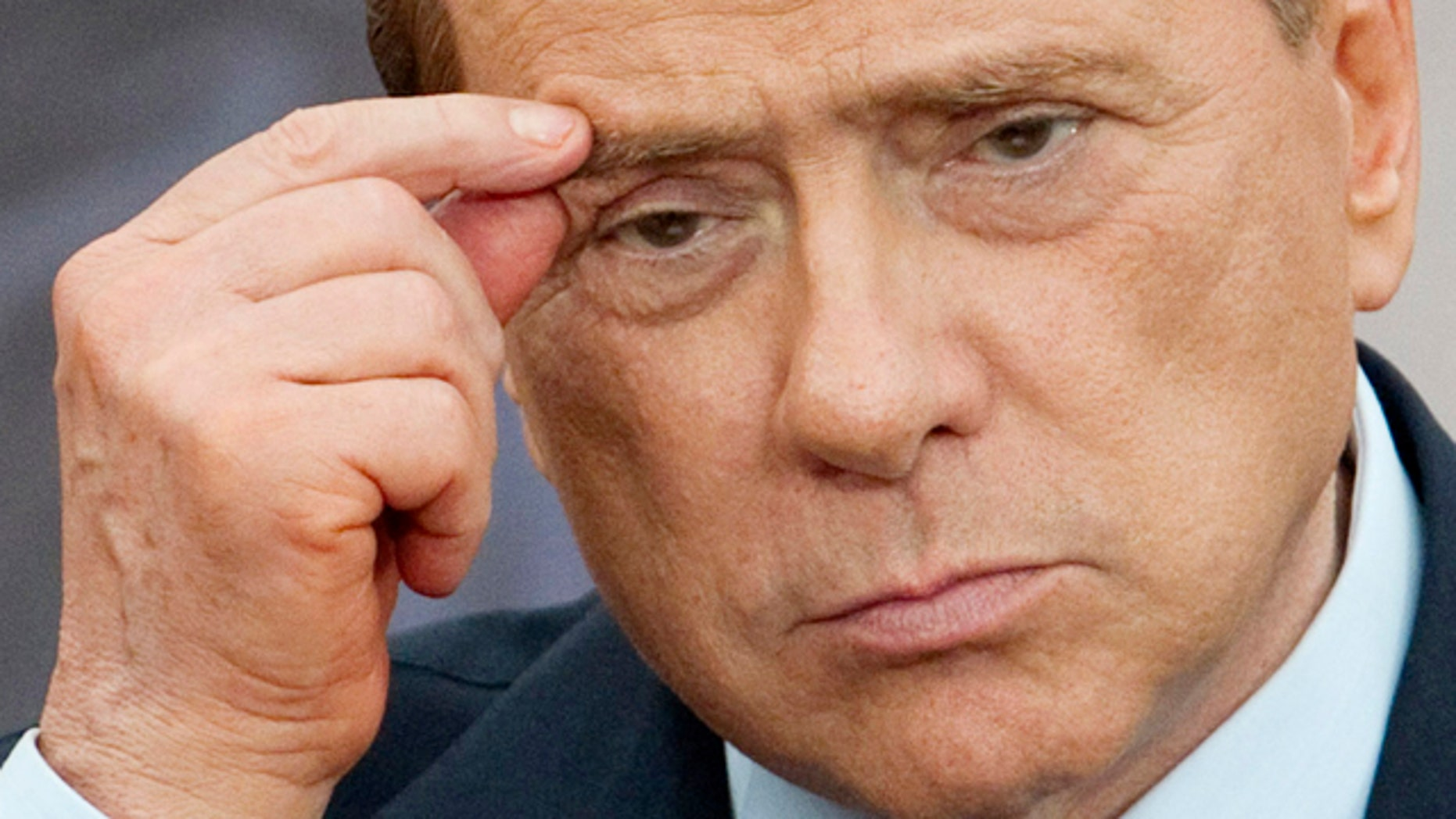 June 13: Italian Premier Silvio Berlusconi gestures during a joint press conference with Israel's Prime Minister Benjamin Netanyahu, in Rome.