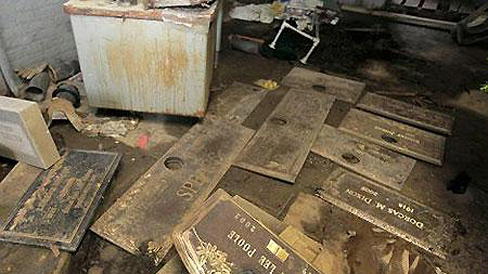 July 10, 2009: Grave markers are seen scattered on the floor of a shack at the Burr Oak Cemetery in Alsip, Ill., where four workers allegedly dug up at least 300 graves and dumped the bodies into unmarked mass graves to resell the plots for a profit. A $7.6 million settlement was later reached, but death care adovcates say problems plaguing the industry aren't limited to 150-acre cemetery.