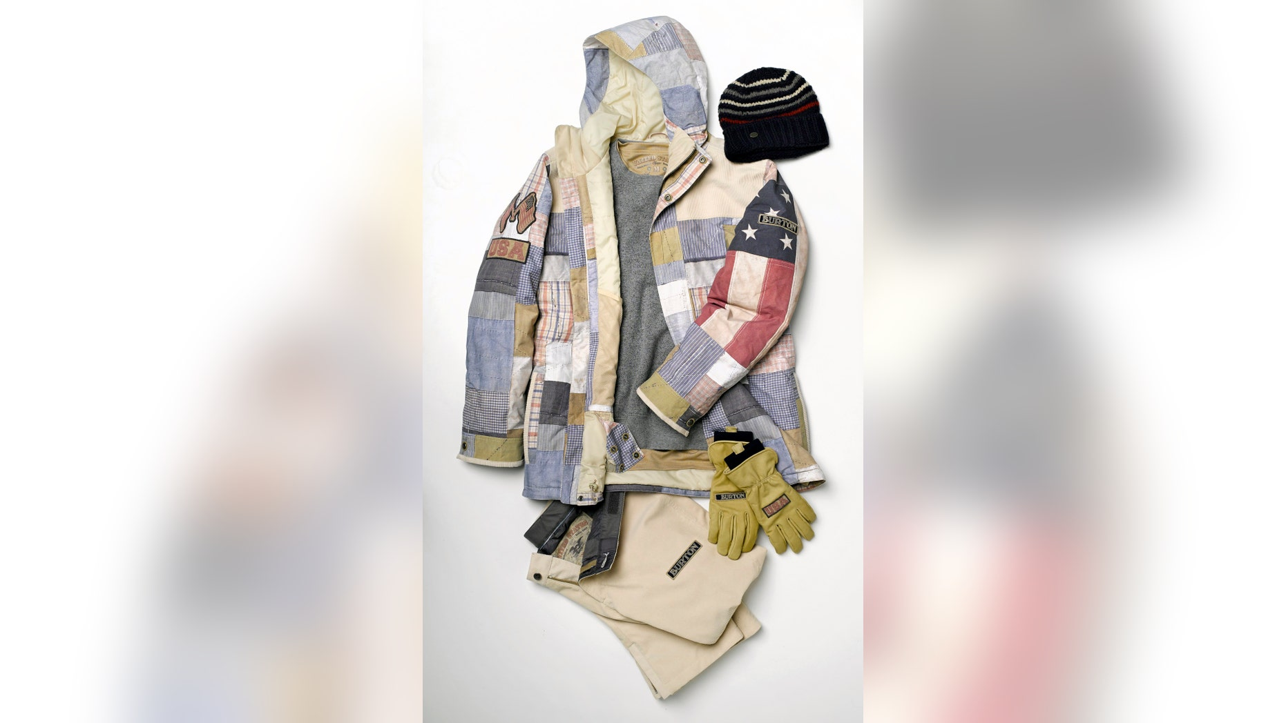 In this undated photo provided by Burton, the U.S. Olympic competition uniform for men snowboarders is shown. The uniforms are built around the competition jacket with squares of stars, stripes and plaids.  (AP/Burton)