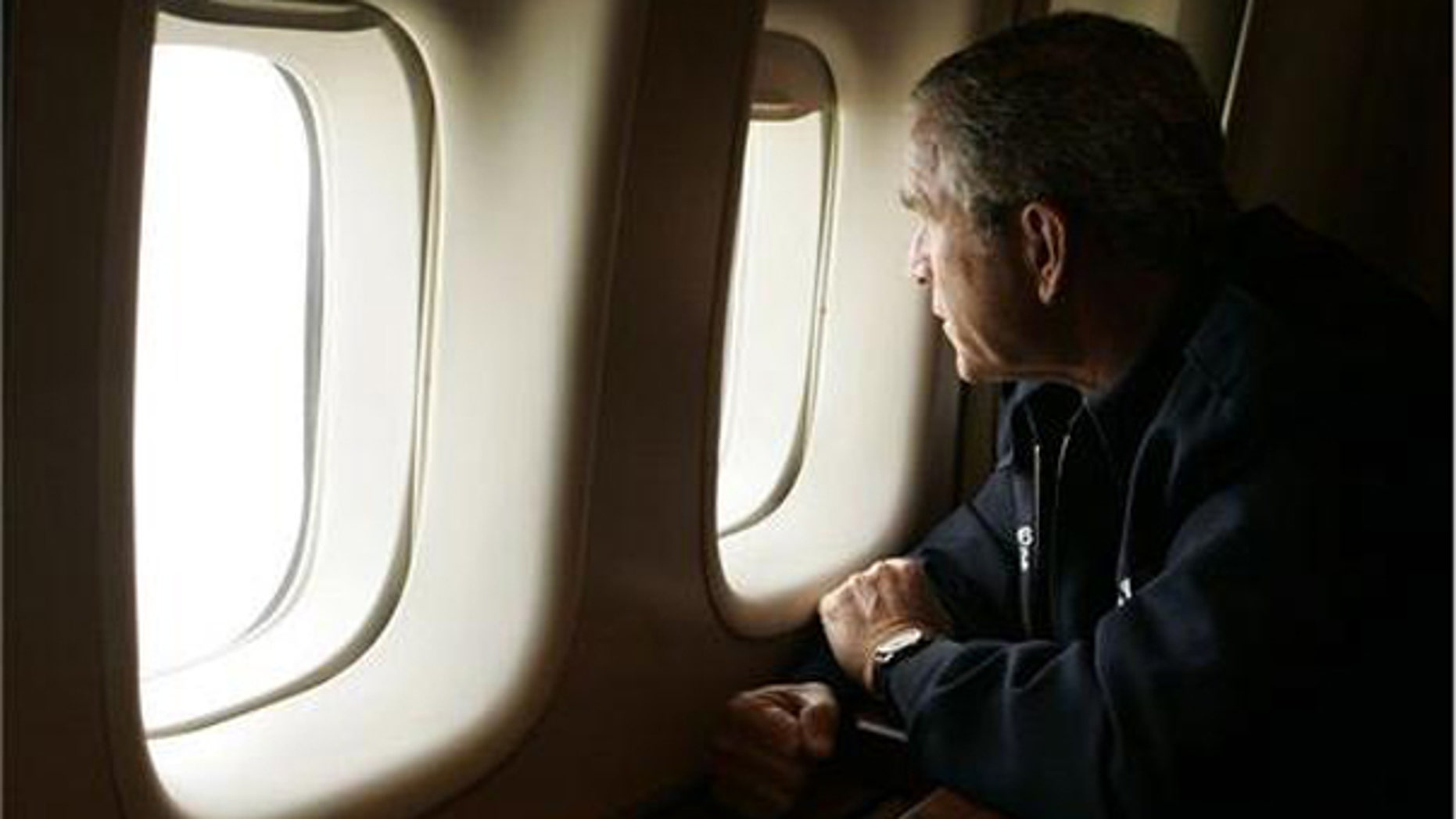 President Bush looks out the window of Air Force One inspecting damage from Hurricane Katrina while flying over New Orleans en route back to the White House. (AP)