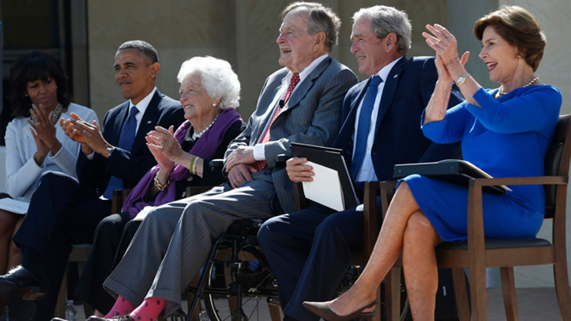 April 25, 2013: From left, President Barack Obama, first lady Michelle Obama, former first lady Barbara Bush, former Presidents George H.W. Bush, George W. Bush, and former first lady Laura Bush take part in the dedication of the George W. Bush presidential library on the campus of Southern Methodist University in Dallas.