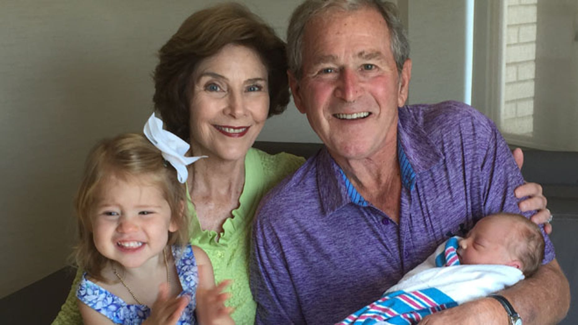 Aug 14, 2015: George W. Bush and his wife Laura hold their new granddaughter, Poppy Louise Hager. (The Bush Family)