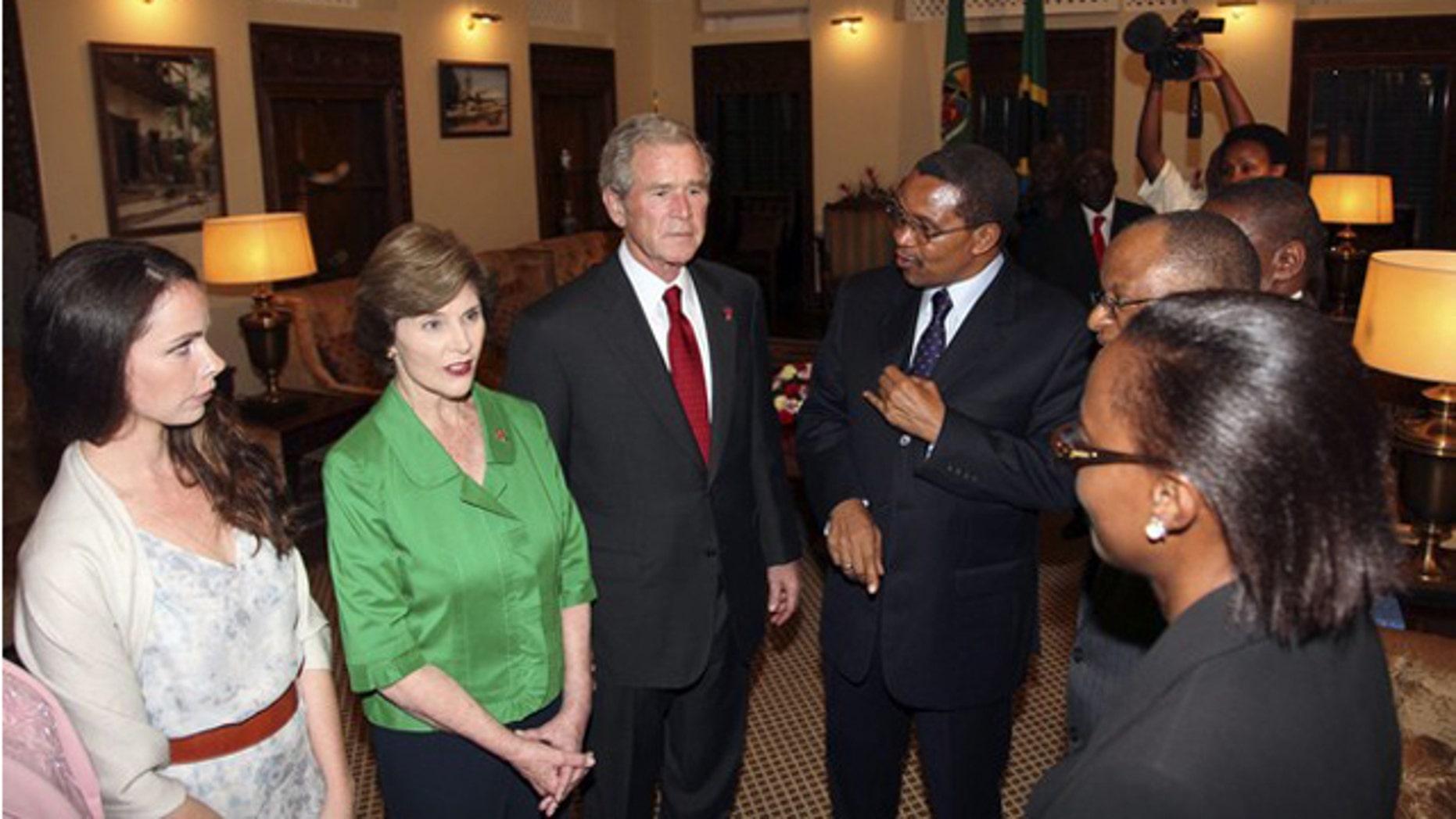 Dec. 1, 2011: Former President George W. Bush speaks with Tanzanian President Jakaya Kikwete upon arriving at the State House in Dar es Salaam.