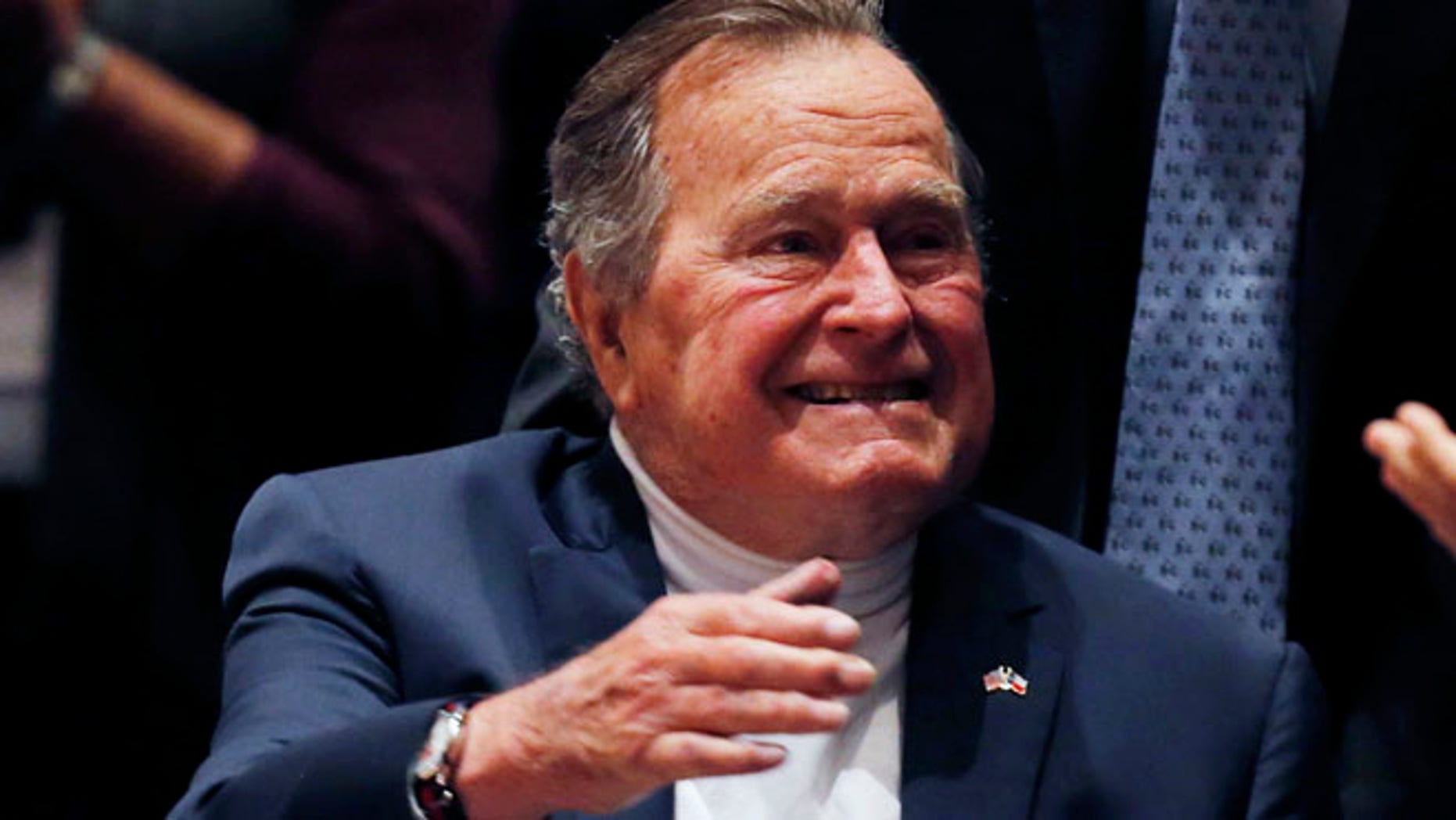 """Nov. 11, 2014: Former United States President George H. W. Bush is brought into the auditorium where his son Former United States President George W. Bush speaks about his new book titled """"41: A Portrait of My Father"""" at the George Bush Presidential Library Center in College Station."""