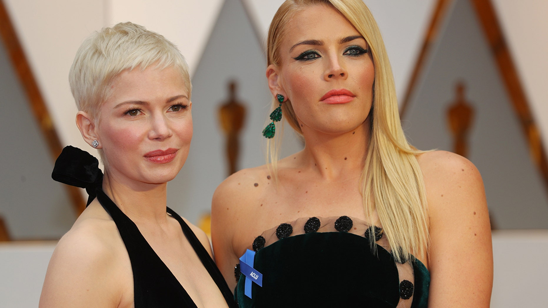 Michelle Williams (left) and Busy Philipps attend the 89th Academy Awards.