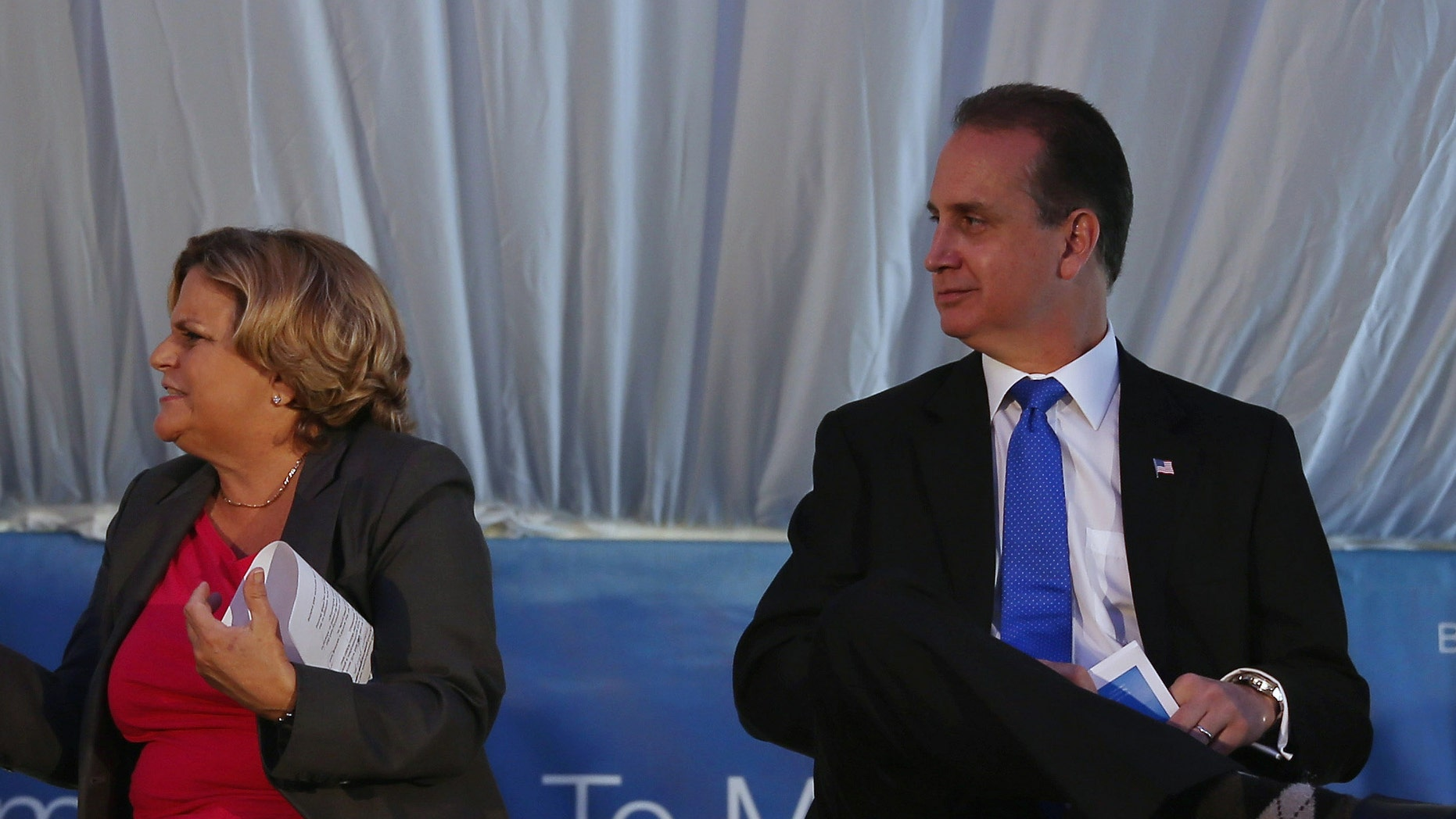 MIAMI, FL - AUGUST 29:  (L-R) Florida Gov. Rick Scott (L) sits with Rep. Ileana Ros-Lehtinen (R-FL), Rep. Mario Diaz-Balart (R-FL) and Rep. Joe Garcia (D-FL) at the grand opening of the main North American training campus for Boeing that includes full-flight simulators for the 787 Dreamliner on August 29, 2013 in Miami, Florida.  Boeing officials say the Miami campus will be one of the largest airline training centers in the world.  (Photo by Joe Raedle/Getty Images)