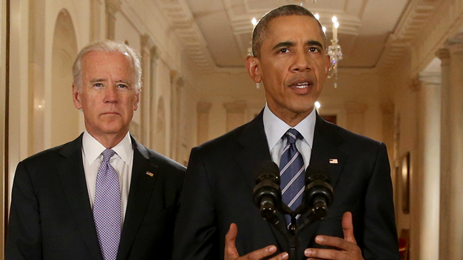 President Obama, standing with Vice President Biden, delivers remarks in the White House on July 14, 2015.