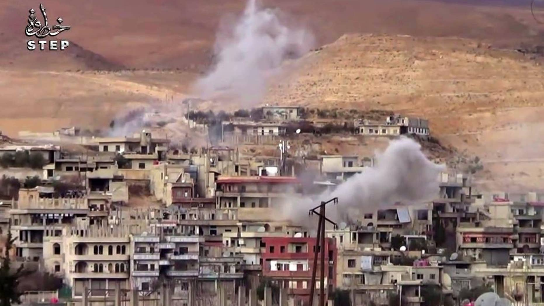 FILE - This file frame grab from video provided on Sunday, Dec. 25, 2016 by Step News Agency, a Syrian opposition media outlet that is consistent with independent AP reporting, shows smoke rise from the government forces shelling on Wadi Barada, northwest of Damascus, Syria. Opposition activists and Syria's state TV said on Friday, Jan. 13, 2017 that maintenance workers have arrived in the rebel-held valley near Damascus to fix the water facility there, ending a violent standoff that has dried out the capital for weeks. (Step News Agency, via AP, File)