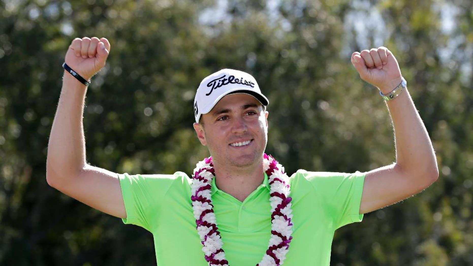 Justin Thomas celebrates after the final round of the Tournament of Champions golf event, Sunday, Jan. 8, 2017, at Kapalua Plantation Course in Kapalua, Hawaii. (AP Photo/Matt York)