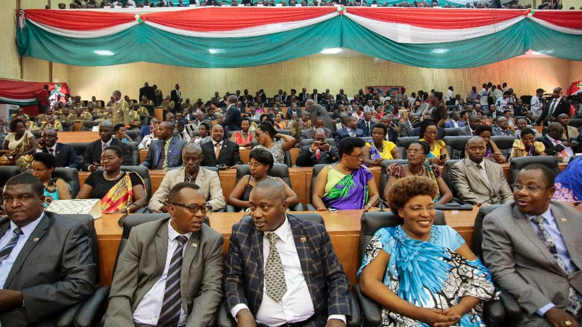 FILE - In this Thursday, Aug. 20, 2015 file photo, members of Burundi's Parliament prepare for the swearing-in ceremony of President Pierre Nkurunziza, in the parliament building in Bujumbura, Burundi. Lawmakers in Burundi overwhelmingly voted Wednesday, Oct. 12, 2016 in support of a plan to withdraw from the International Criminal Court (ICC), escalating a bitter dispute with the international community over the human rights situation in the East African country, although the decision is not immediate. (AP Photo/Gildas Ngingo, File)