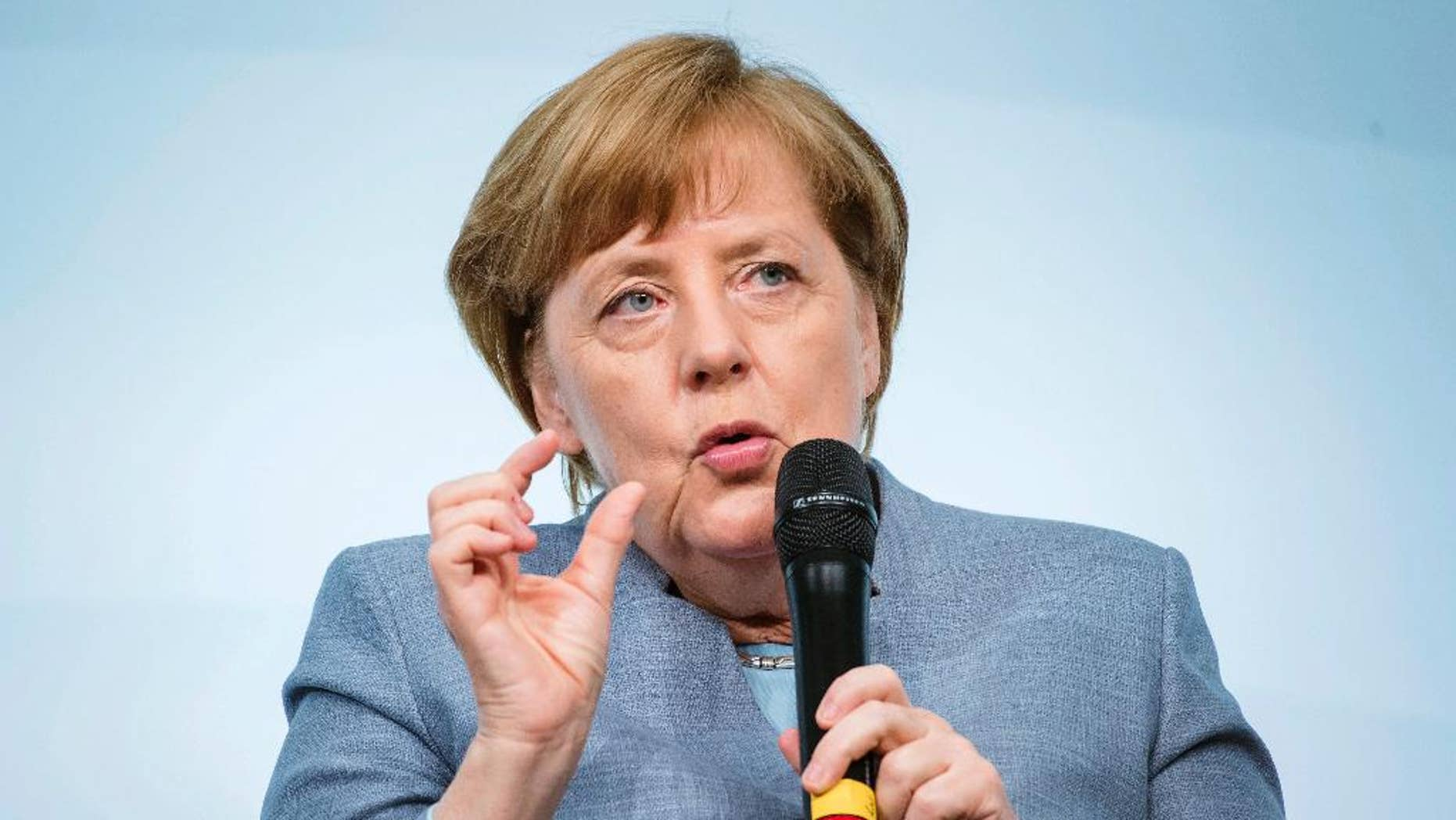 German Chancellor Angela Merkel speaks at the W20 Summit in Berlin, Germany, Wednesday, April 26, 2017. The conference aims at building support for investment in women's economic empowerment programs. (Gregor Fischer/dpa via AP)
