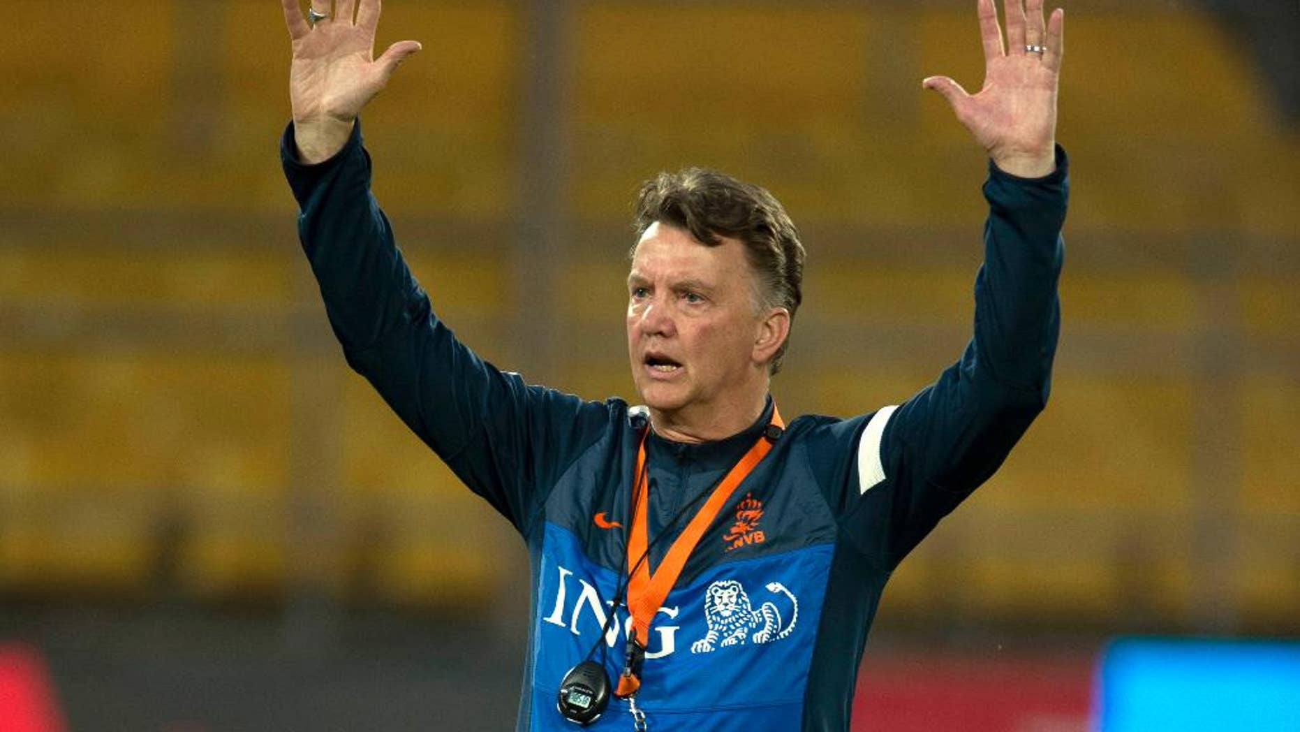 FILE - In this June 10, 2013,file photo Netherlands' coach Louis van Gaal gestures during practice, a day before a friendly soccer match against the Chinese national team at the Worker's Stadium in Beijing, China. Van Gaal, who will be replaced by Guus Hiddink after the tournament, has rebuilt the team to play more attractive attacking football. (AP Photo/Ng Han Guan, File)