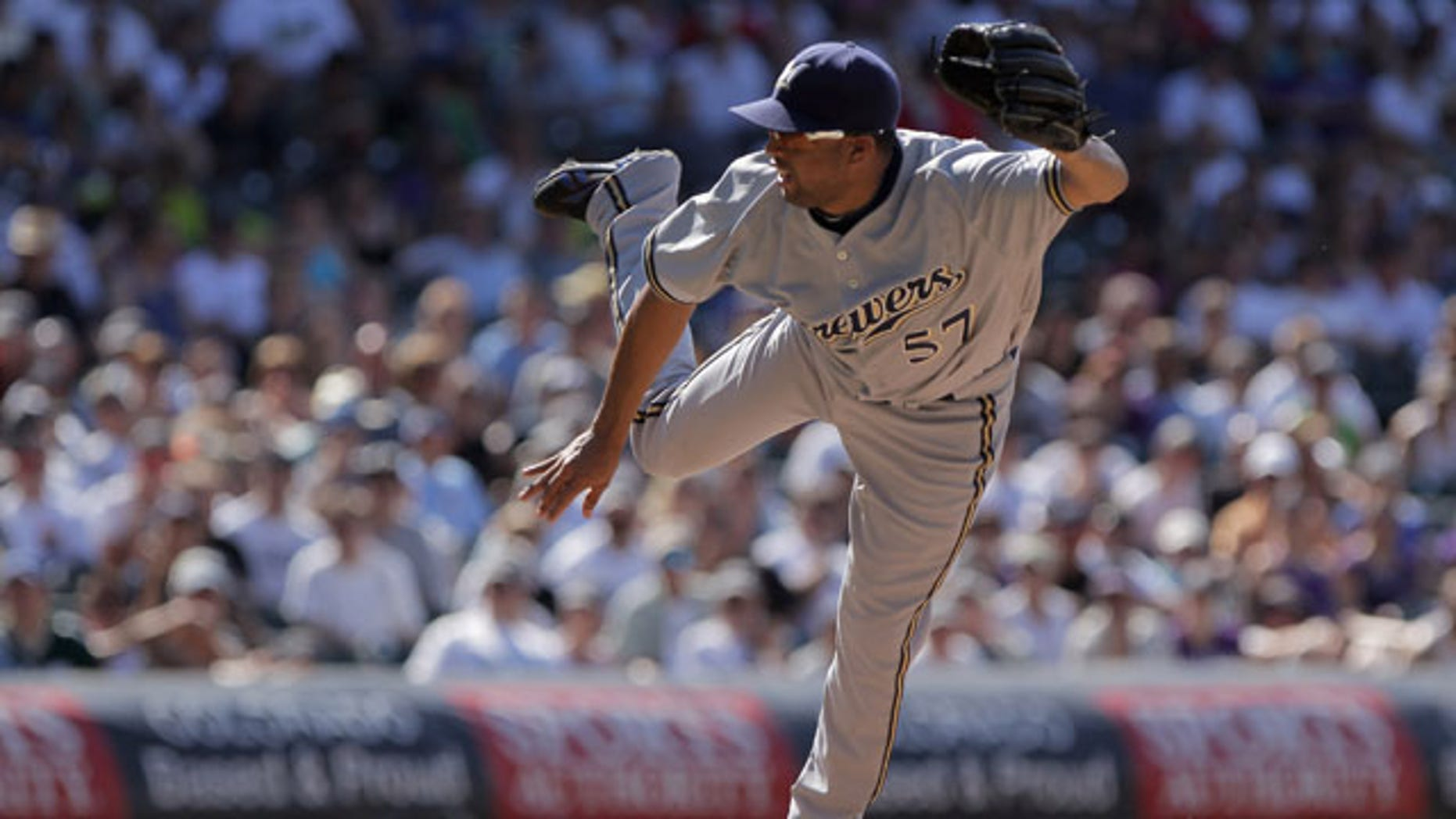 DENVER, CO - JULY 17:  Relief pitcher Francisco Rodriguez #57 of the Milwaukee Brewers delivers against the Colorado Rockies at Coors Field on July 17, 2011 in Denver, Colorado. Rodriguez earned a hold as they Brewers defeated the Rockies 4-3.  (Photo by Doug Pensinger/Getty Images)